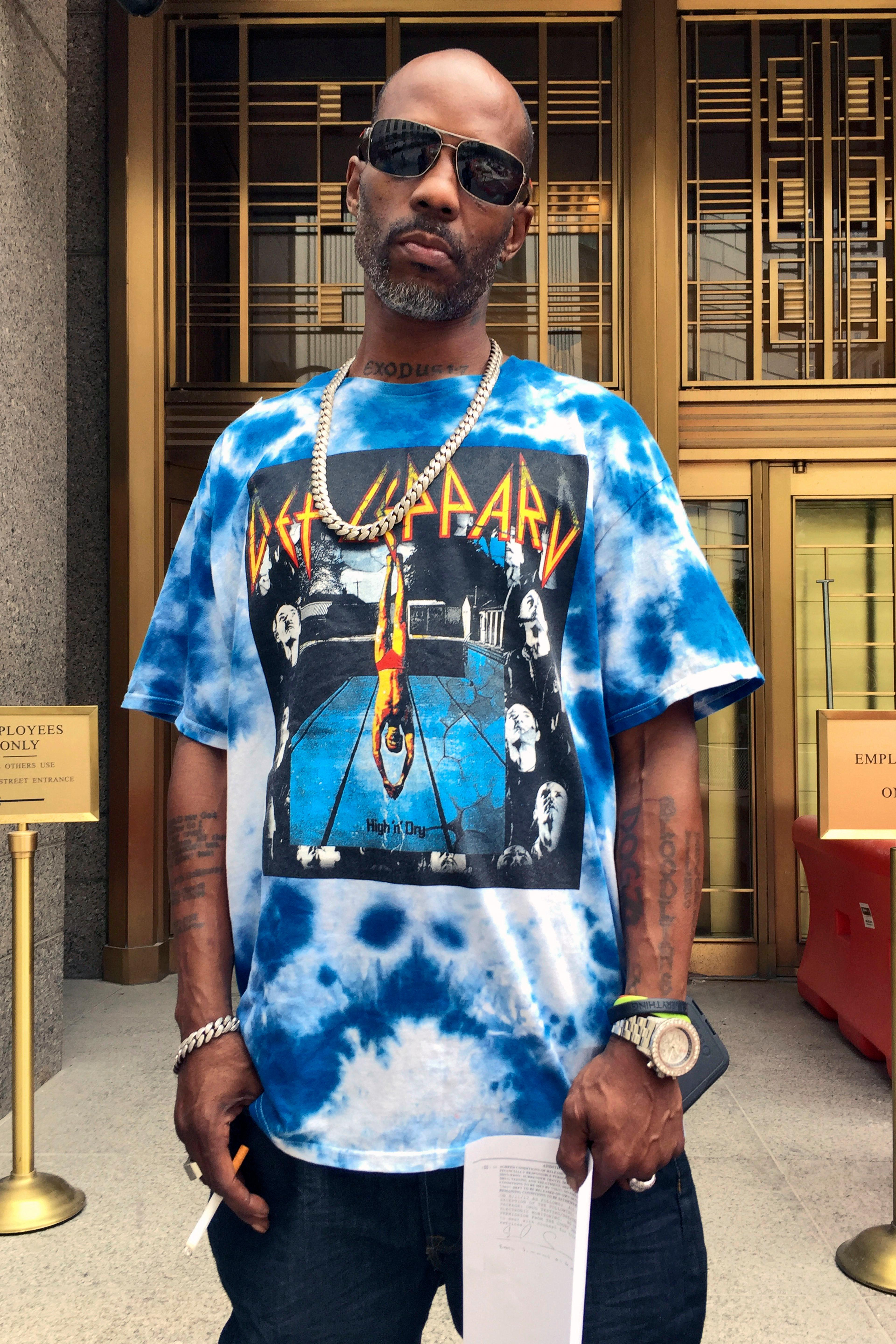 Rapper DMX, whose given name is Earl Simmons, poses for a photo outside federal court, in New York, Friday, Aug. 11, 2017. DMX, who prosecutors say owes $1.7 million in taxes, was ordered confined to his suburban New York City home Friday by a judge who said he repeatedly violated bail conditions on the tax fraud charges. (AP Photo/Larry Neumeister)