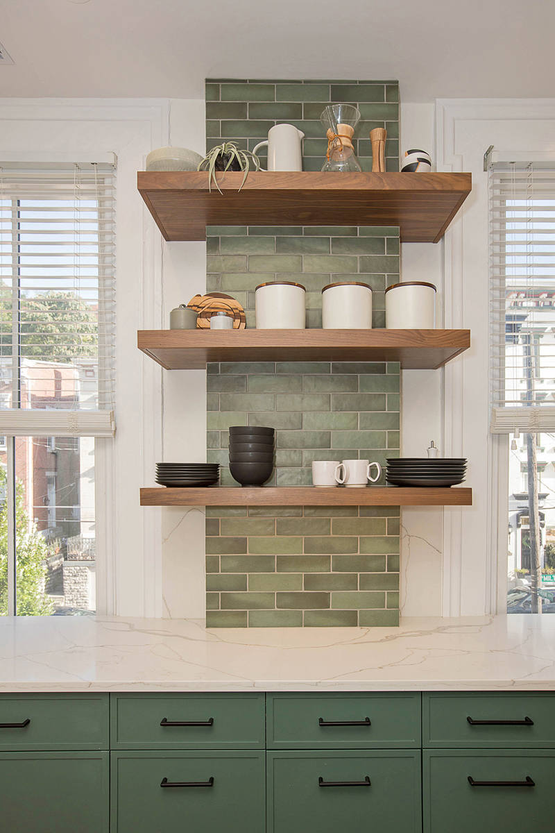 "The windows were left untouched due to existing historic regulations, so the kitchen's redesign worked around them and incorporated each one into the new layout in a meaningful way. According to Neal's blog, the windows ""provide equally-spaced visual breaks that help create distinct zones for the kitchen's various tasks."" / Image courtesy of Neal's Design Remodel // Published: 11.1.20"
