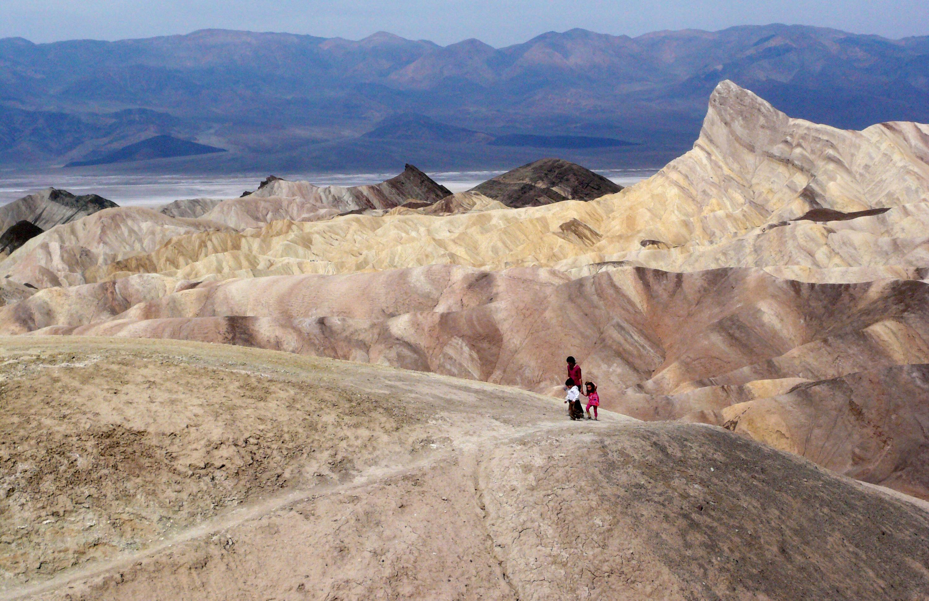 FILE - In this April 11,2010 file photo, tourists walk along a ridge at Death Valley National Park, Calif.    (AP Photo/Brian Melley, File)