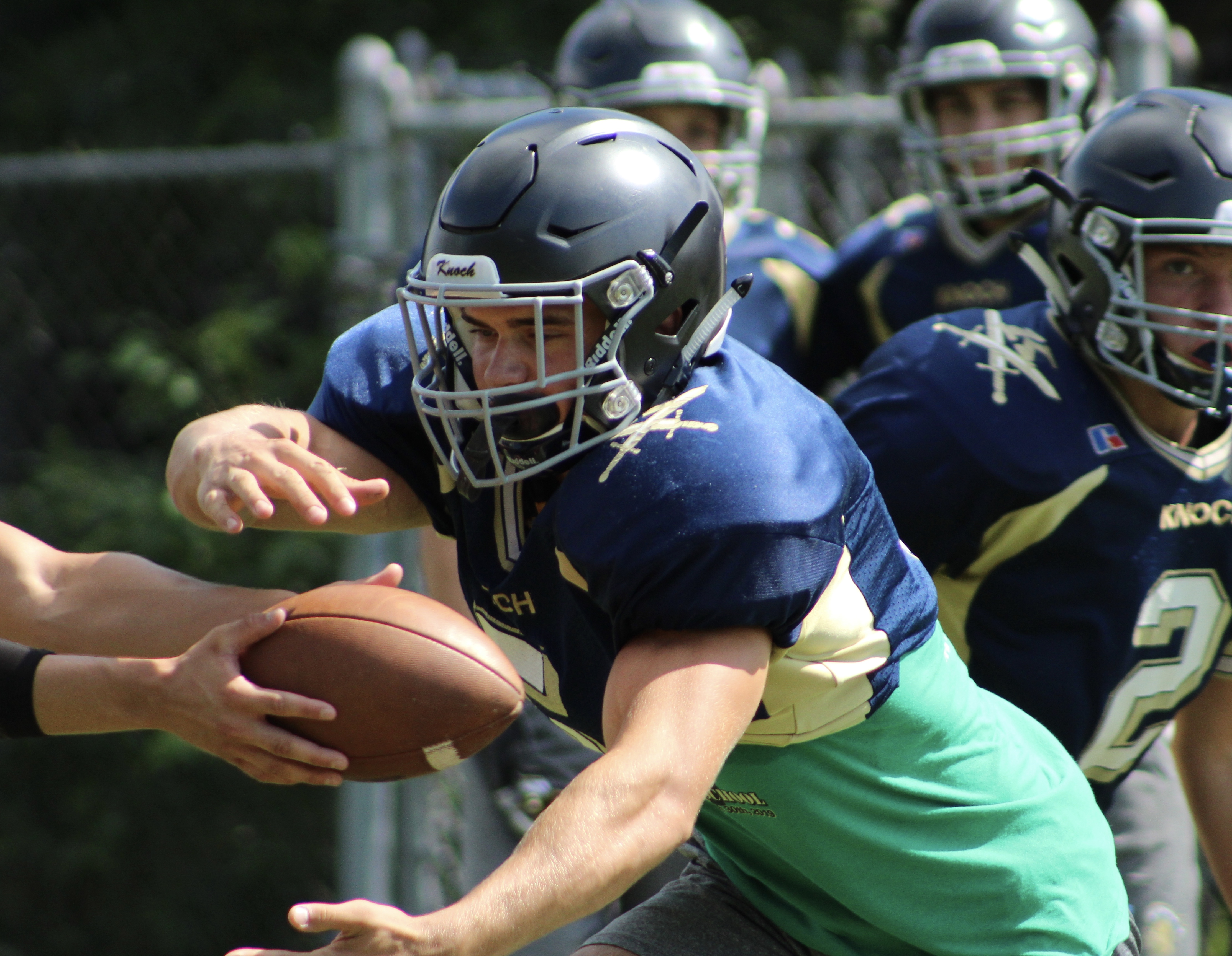 "Knoch High School running back Matt Goodlin takes a hand-off during an August practice.{ }Watch the AHN Friday Night Rivals powered by IGS Energy ""Kickoff Special"" Aug. 23 at 7 p.m. on 22 the Point."