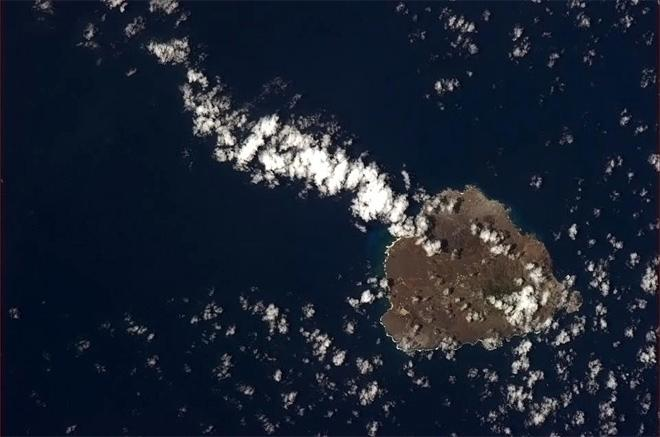 Ascension Island with a kite's tail of cloud. Darwin climbed the volcano in 1836. (Photo & Caption: Chris Hadfield/NASA)