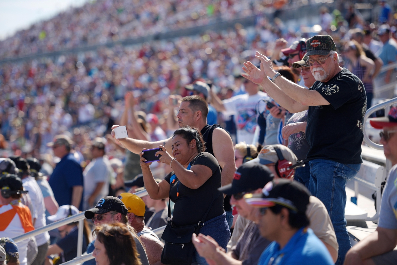 Race fans stand for a restart during the NASCAR Xfinity Series Boyd Gaming 300 Saturday, March 11, 2017, at the Las Vegas Motor Speedway. (Sam Morris/Las Vegas News Bureau)