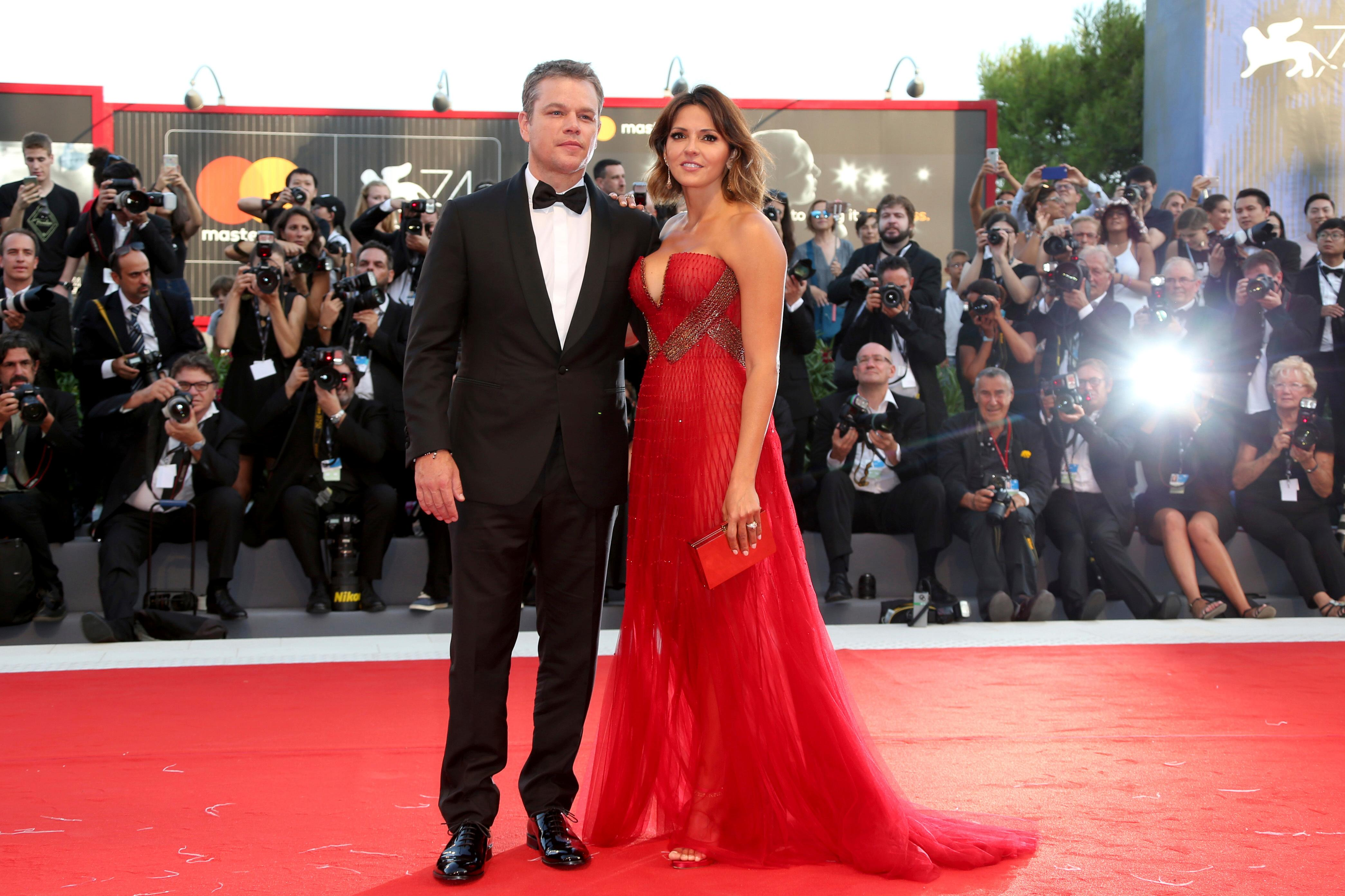 Actor Matt Damon, left, and his wife Luciana Barroso pose for photographers at the premiere of the film 'Downsizing' which opens the 74th edition of the Venice Film Festival in Venice, Italy, Wednesday, Aug. 30, 2017. (Photo by Joel Ryan/Invision/AP)