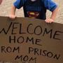 Boy welcomes mom home at airport with funny sign