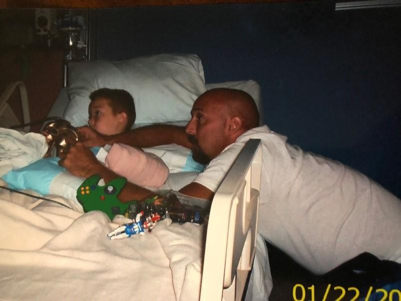 Jacob and his father in the hospital (photo: KATV/Tinsley family)