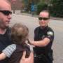 Charleston police officers comfort children after mother is arrested on drug charges
