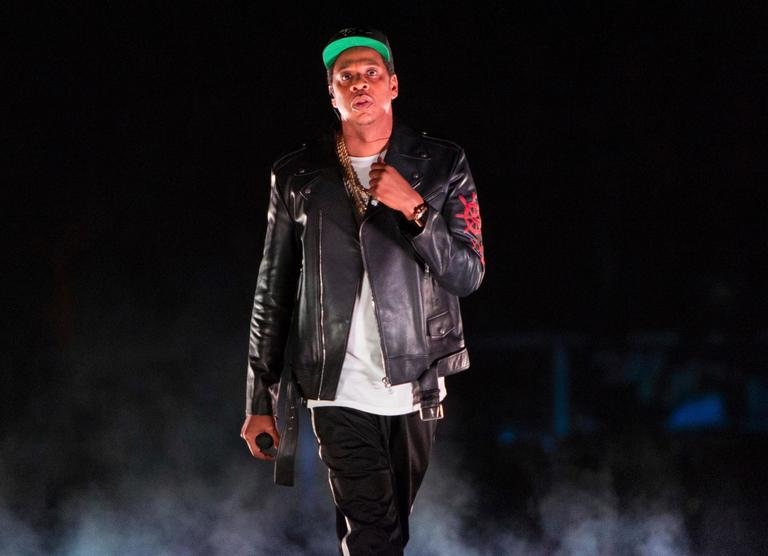 FILE - In this Nov. 26, 2017 file photo, Jay-Z performs on the 4:44 Tour at Barclays Center in New York. The rapper was nominated for eight Grammy nominations on Tuesday, Nov. 28. Four of the five album of the year nominees at the 2018 Grammys are rap and R&B-based albums from black or Latino artists, including Jay-Z. (Photo by Scott Roth/Invision/AP, File)