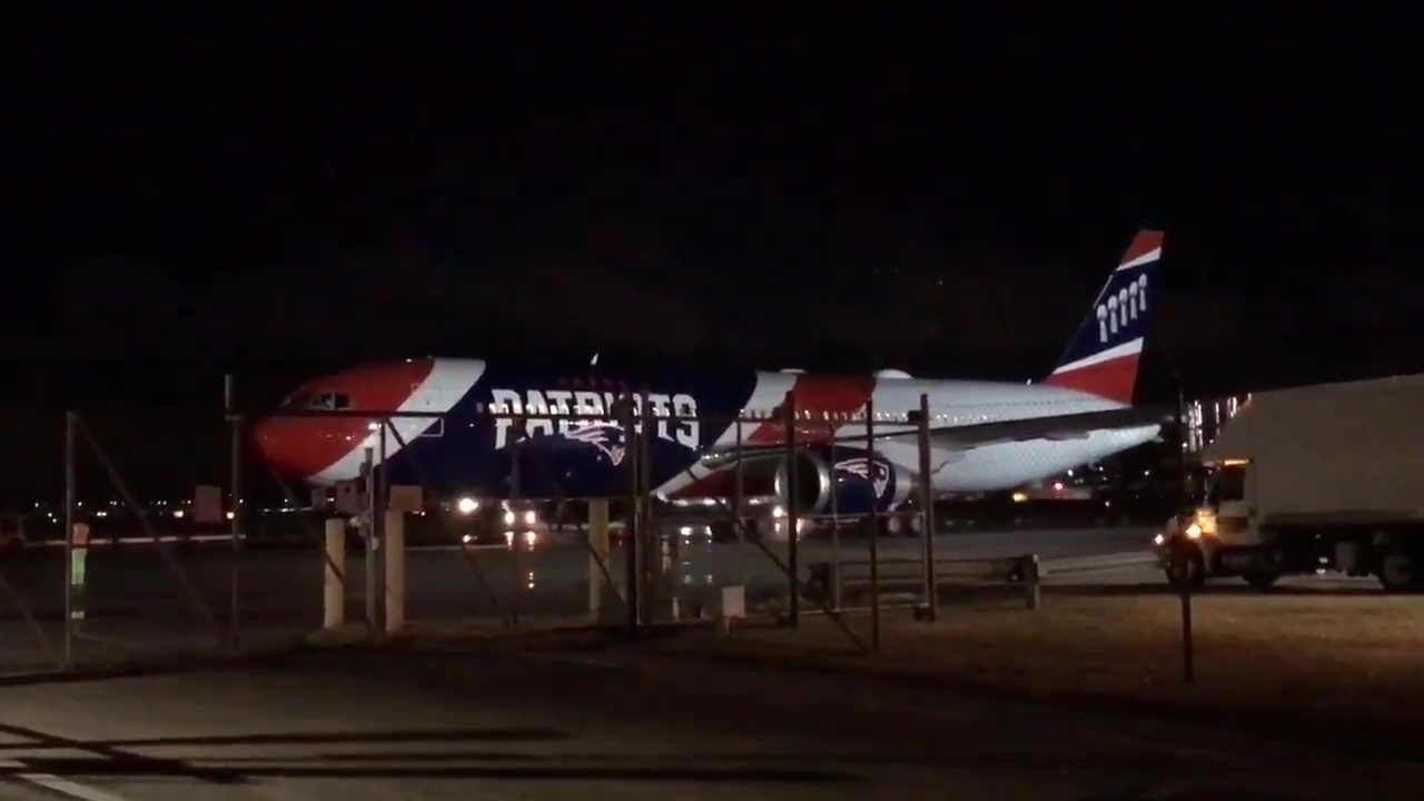 A New England Patriots plane carrying fans and family members lands at T.F. Green Airport in Warwick, early Monday, Feb. 5, 2018. (WJAR)