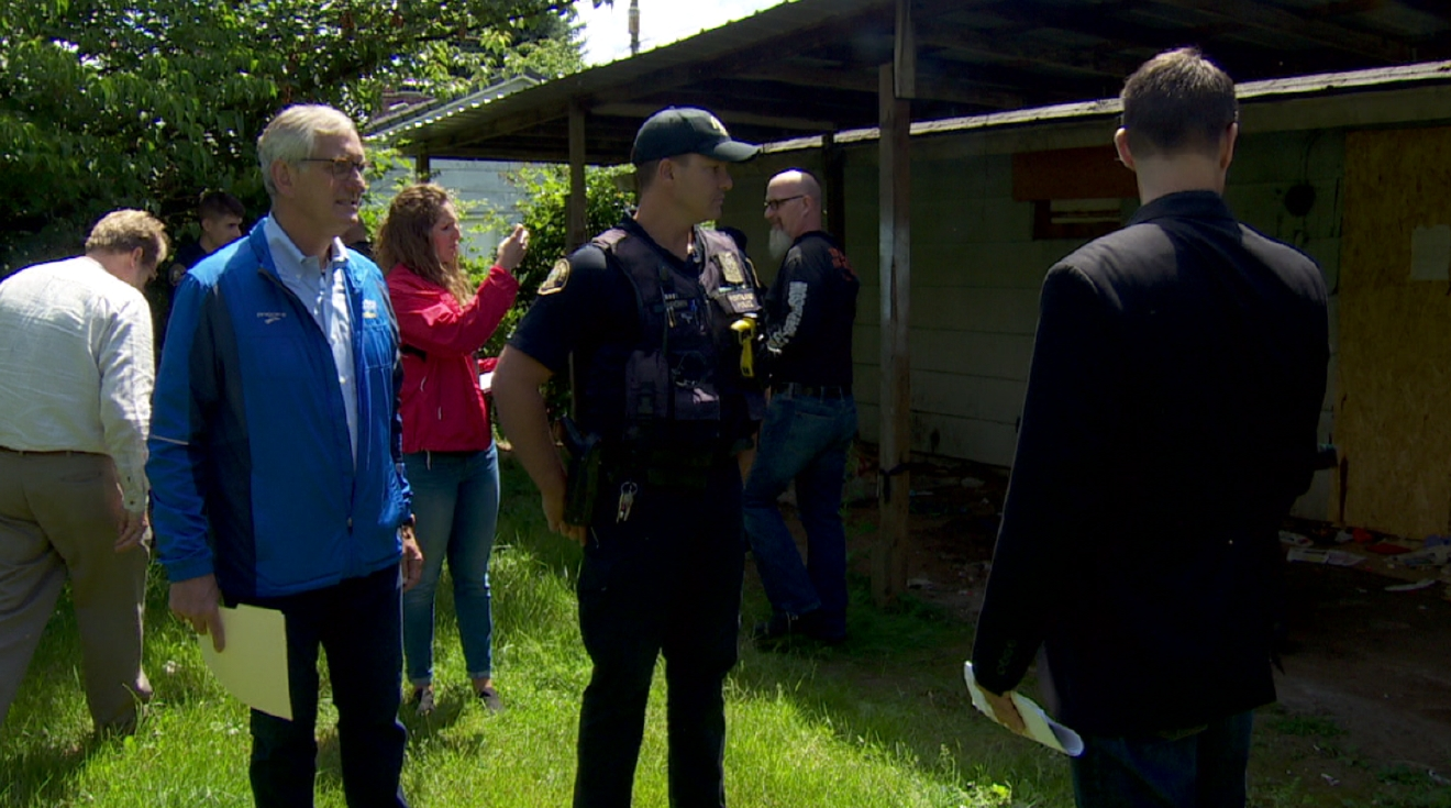 Portland Mayor Charlie Hales toured several zombie homes Friday, June 10 (KATU News photo)