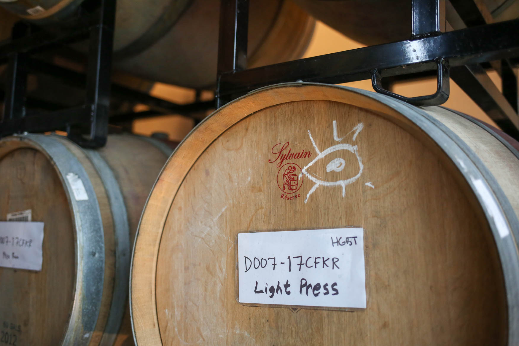 Each barrel has notes about the wine inside and the processing it's received. (Amanda Andrade-Rhoades/DC Refined)<p></p>