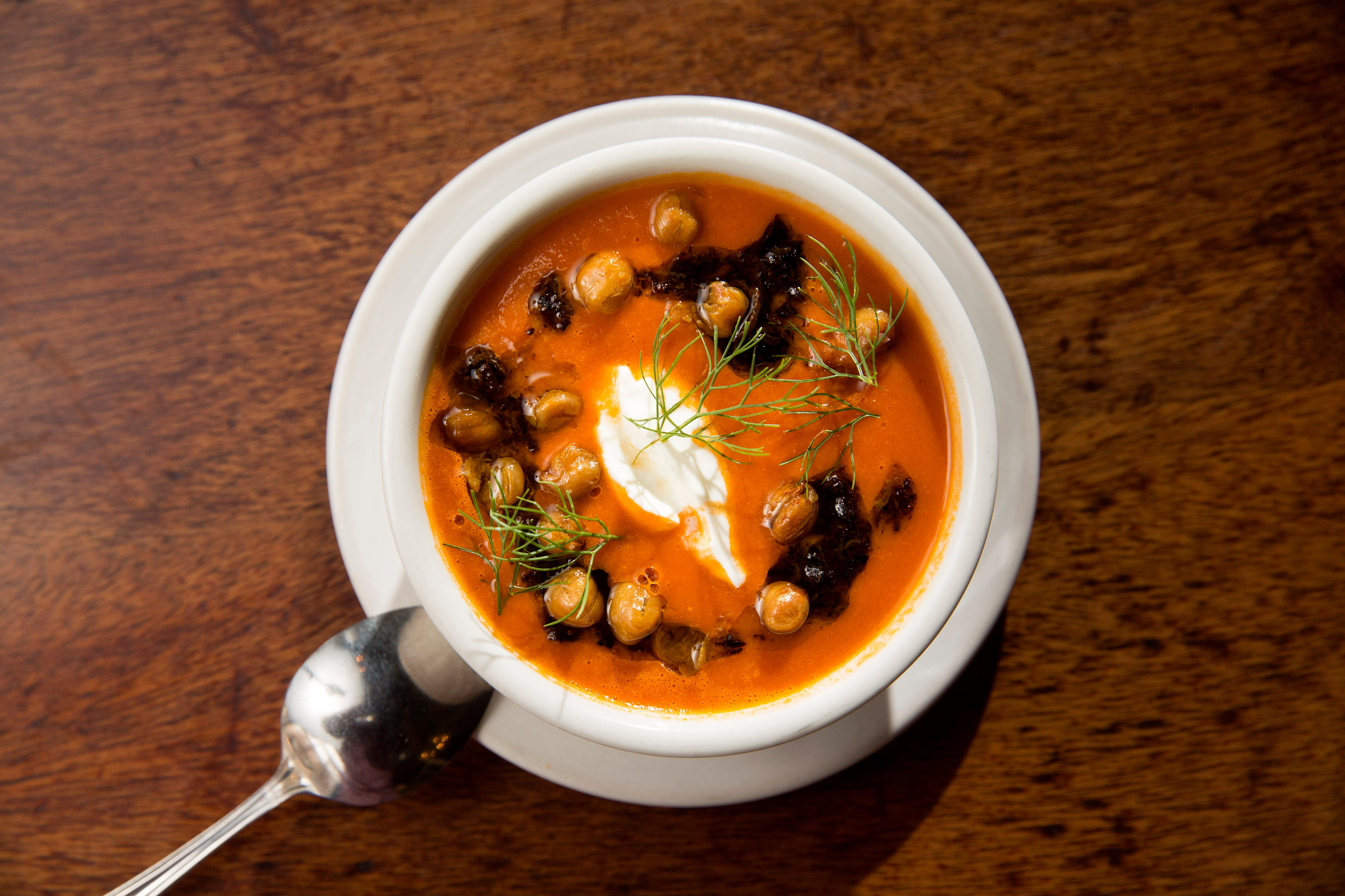 Chef Abby Canfield cooks up up a Tomato and Fennel Soup, with oil cured olive tapenade, fried chickpeas, and whipped yogurt, for Seattle Restaurant Week. (Sy Bean / Seattle Refined)
