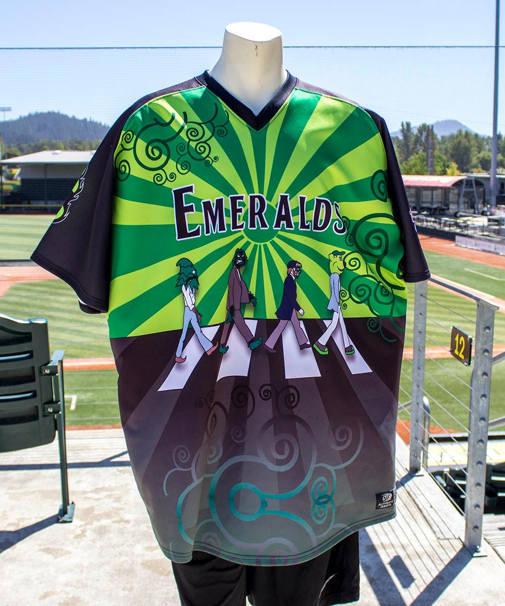 Danny Cowley's first graphic jersey design made its debut on the diamond for Beatles Night. The Eugene Emeralds will hold a Throwback Thursday and Teacher Appreciation Night August 18. Teachers can get free box seats. (Photo by Amanda Butt)
