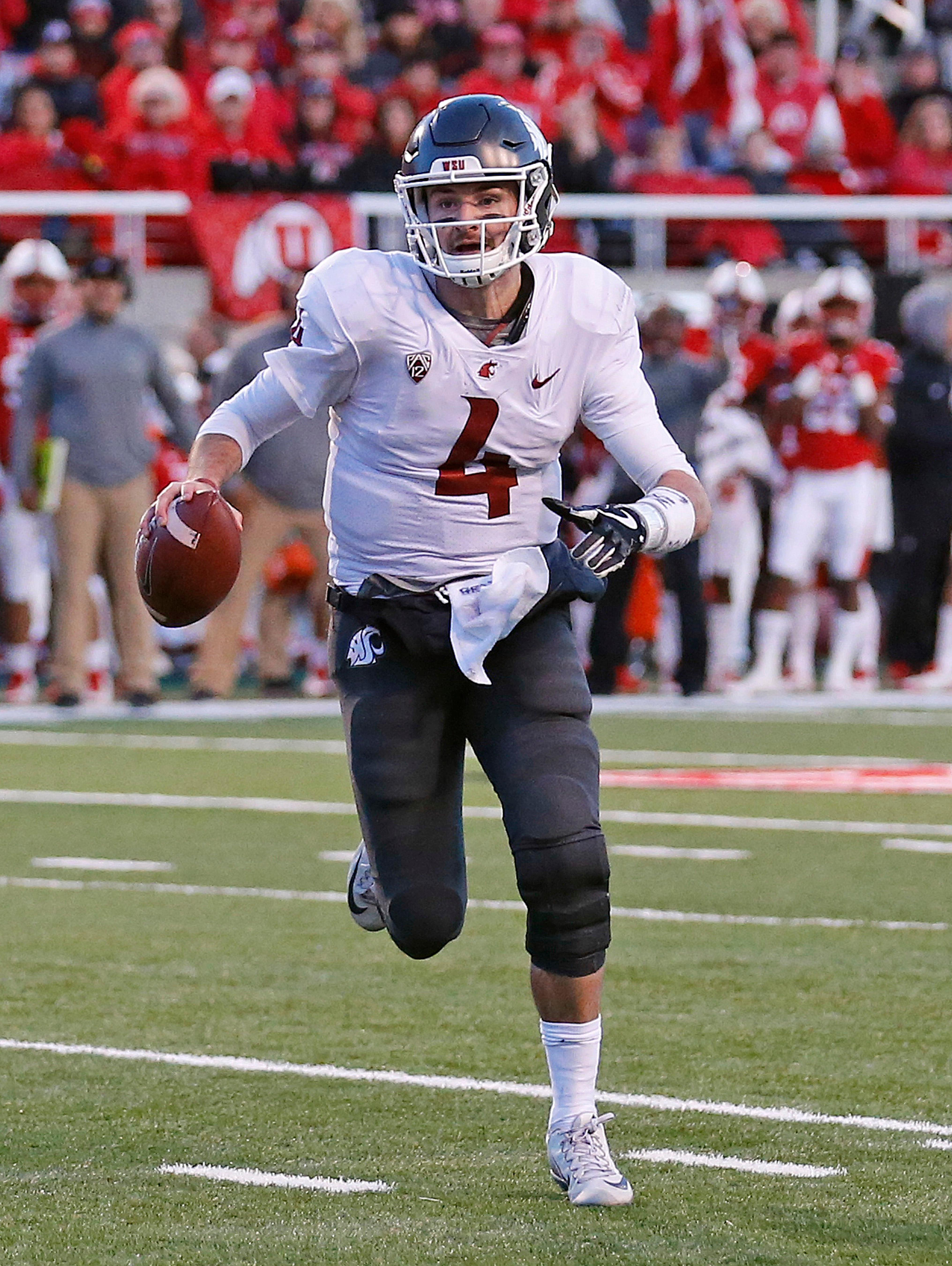 Washington State quarterback Luke Falk (4) carries the ball against Utah in the first half of an NCAA college football game, Saturday, Nov. 11, 2017, in Salt Lake City. (AP Photo/Rick Bowmer)