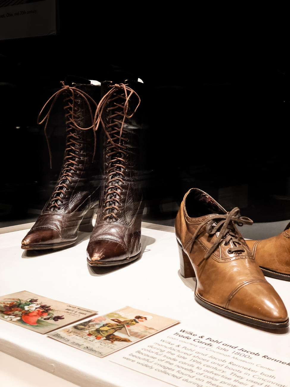 Lace-up Boots by Juliam & Kokenge Company (1910), and Red Cross Noiseless Shoes by Kron-Fechheimer & Co. (1918). Both shoes were made in Cincinnati. / Image: Phil Armstrong, Cincinnati Refined // Published: 3.1.21