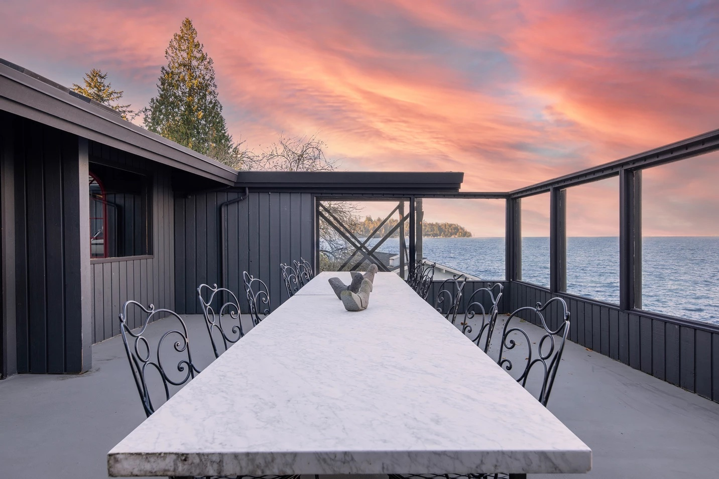 "This mid-century home on{&nbsp;}Vashon Island is all-around stunning, but the one feature that immediately stands out is its epic pool with a mural of David Bowie — seriously, how cool is that?! The 5,500-square-foot main residence has five bedrooms and 3.5 bathrooms, with three additional bedrooms and a bathroom in the guest residence. This property boasts nearly 300 ft. of private waterfront with beautiful views, a boat launch and custom wine storage. Listed by{&nbsp;}Kayse Gundram of Windermere. More info{&nbsp;}<a  href=""https://www.k2compound.com/"" target=""_blank"" title=""https://www.k2compound.com/"">online</a>. (Image:{&nbsp;}Kayse Gundram/Windermere Real Estate){&nbsp;}"