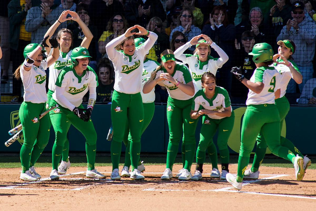 Oregon center fielder Shannon Rhodes (#9) is greated by fellow Ducks at home plate following her home run hit. The Oregon Ducks defeated the Oregon State Beavers seven to zero on Sunday, April 30, 2017. The Ducks' victory marked the third victory of the three game sweep against the Beavers. Photo by Ben Lonergan, Oregon News Lab