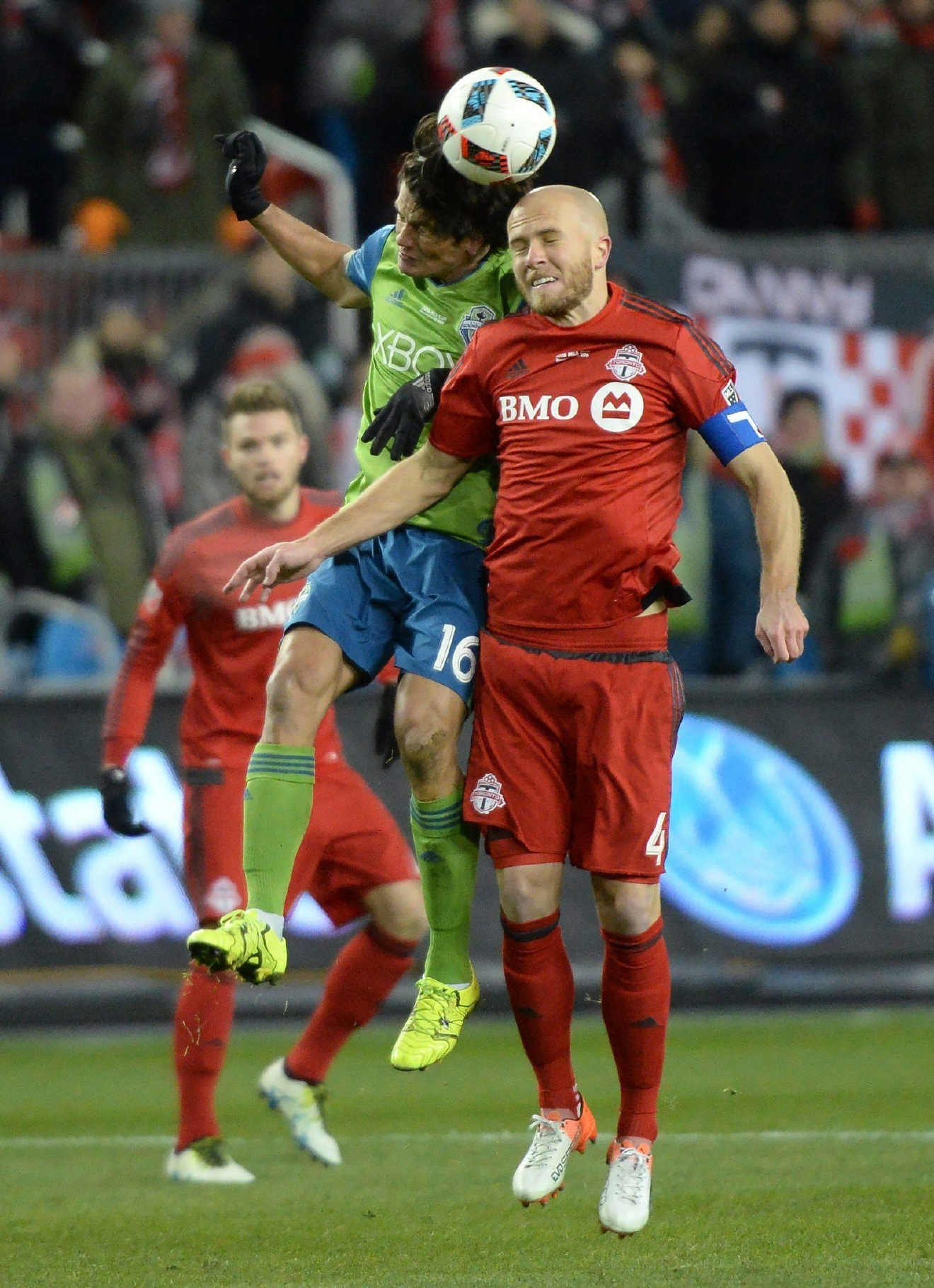 Seattle Sounders forward Nelson Valdez, left, and Toronto FC midfielder Michael Bradley challenge for the ball during first-half MLS Cup final soccer action in Toronto, Saturday, Dec. 10, 2016. (Nathan Denette/The Canadian Press via AP)