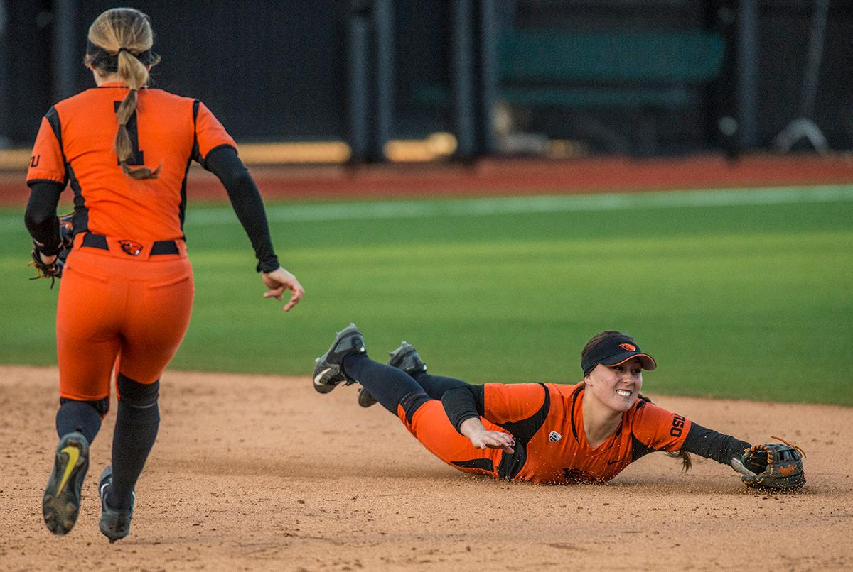 Oregon State Beavers shortstop McKenna Arreola (#27) misses as she dives for the ball. The Oregon Ducks defeated the Oregon State Beavers 8-0 in game one of the three-game Civil War series on Friday night at Jane Sanders Stadium. The game was 0-0 until Gwen Svekis (#21) hit a solo home run in the fourth inning. Mia Camuso hit a grand slam in the fifth inning, ending the game for the Ducks by mercy rule. With tonight's victory, the Ducks are 39-6 and 12-6 in Pac-12 play. Photo by Rhianna Gelhart, Oregon News Lab