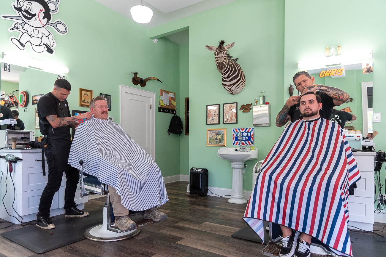 <p>Clients are encouraged to book online (Bellevue-Barbershop.com) to ensure they don't have to wait for a cut. If they do, they get free refreshments from the fridge. The shop is cash only, and a standard haircut costs $25. / Image: Phil Armstrong, Cincinnati Refined // Published: 7.10.20</p>