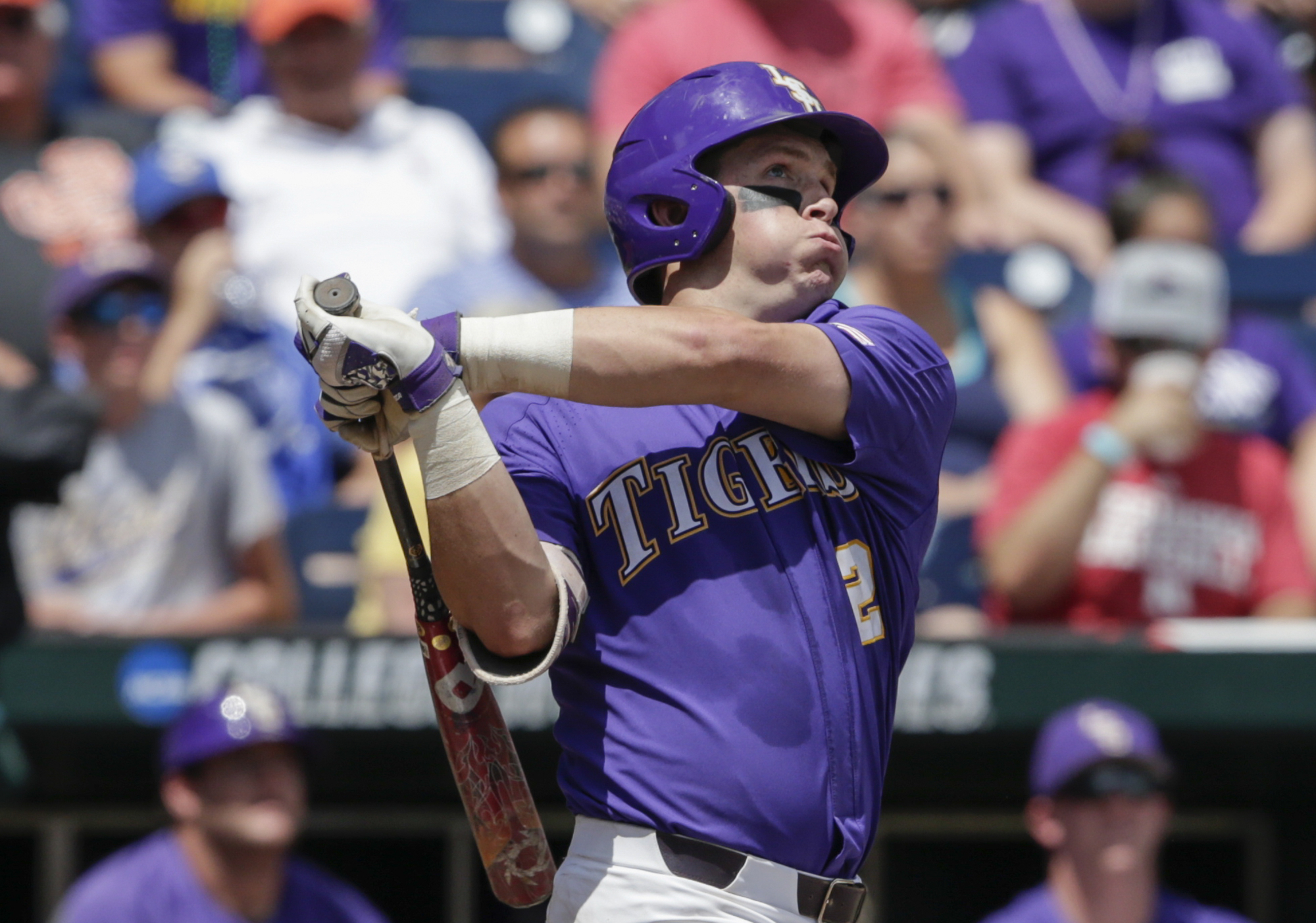 LSU's Michael Papierski (2) follows through on his three-run home run against Oregon State in the third inning of an NCAA College World Series baseball elimination game in Omaha, Neb., Saturday, June 24, 2017. (AP Photo/Nati Harnik)