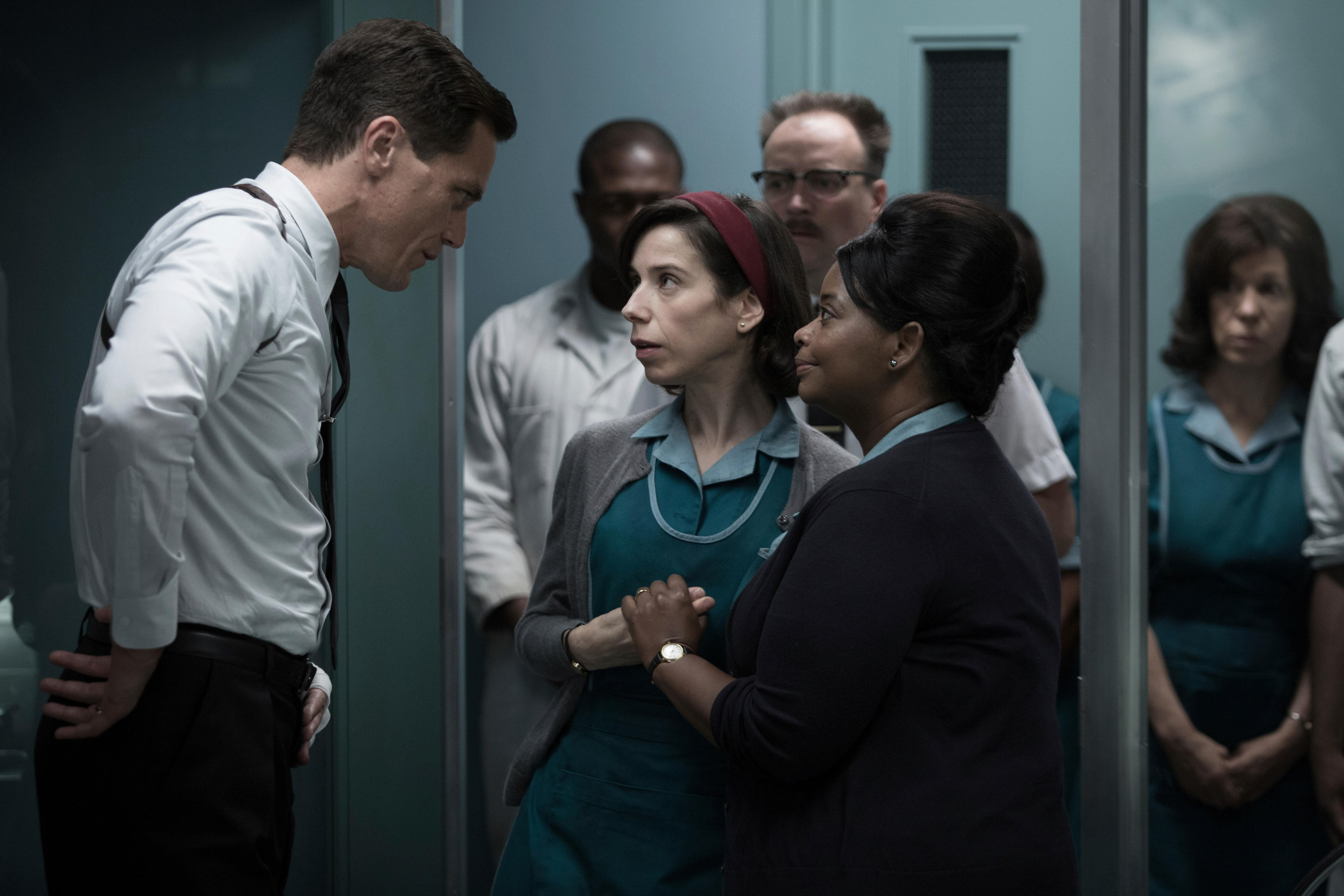 "This image released by Fox Searchlight Pictures shows Michael Shannon, from left, Sally Hawkins and Octavia Spencer in a scene from the film, ""The Shape of Water."" Guillermo del Toro's Cold War fantasy tale is the leading nominee at the Critics' Choice Awards. It received 14 nominations, including for best picture, best actress for Sally Hawkins and best director for del Toro. (Fox Searchlight Pictures via AP)"