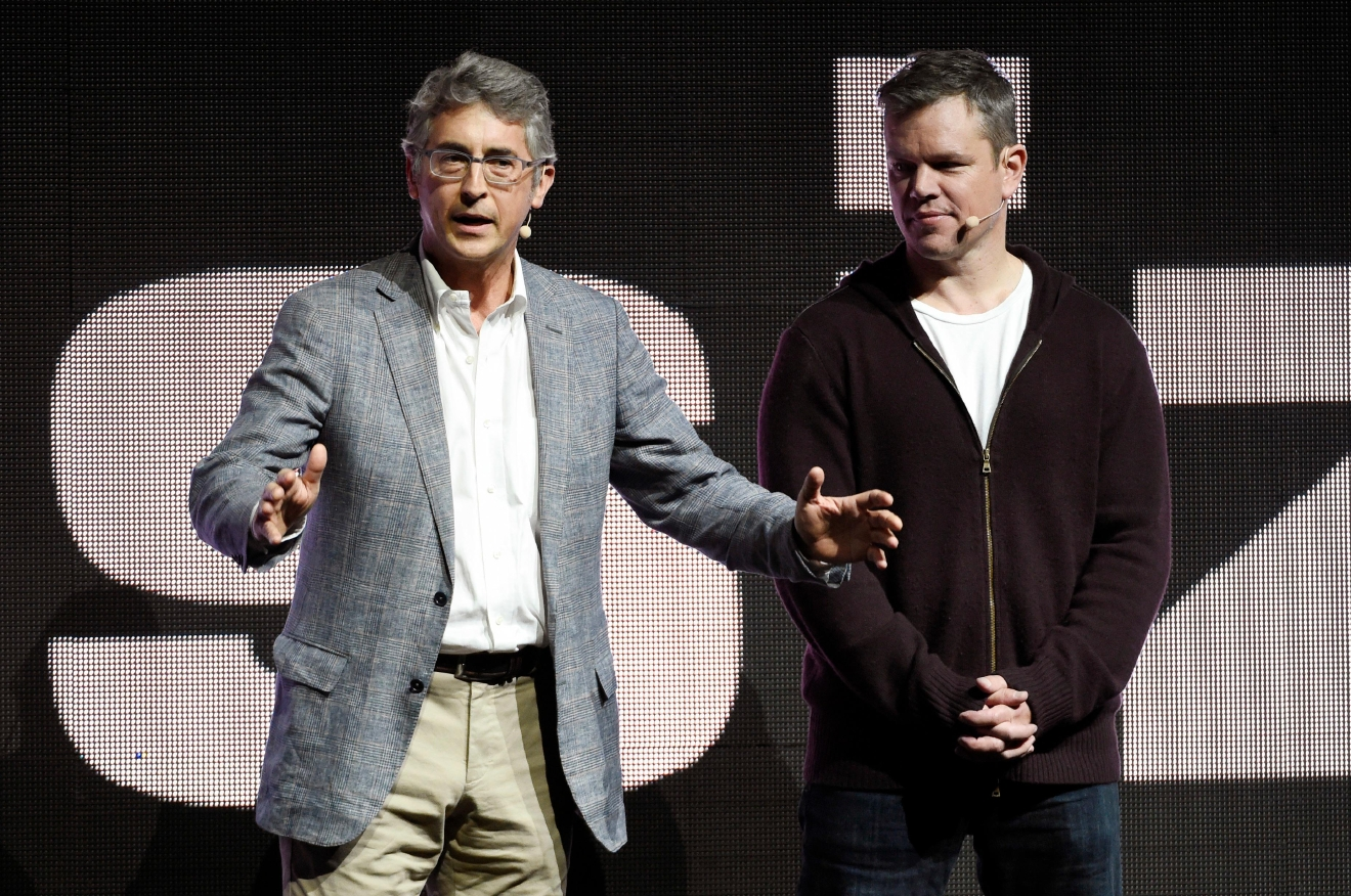 "Alexander Payne, left, co-writer/director of the upcoming film ""Downsizing,"" addresses the audience as cast member Matt Damon looks on during the Paramount Pictures presentation at CinemaCon 2017 at Caesars Palace on Tuesday, March 28, 2017, in Las Vegas. (Photo by Chris Pizzello/Invision/AP)"