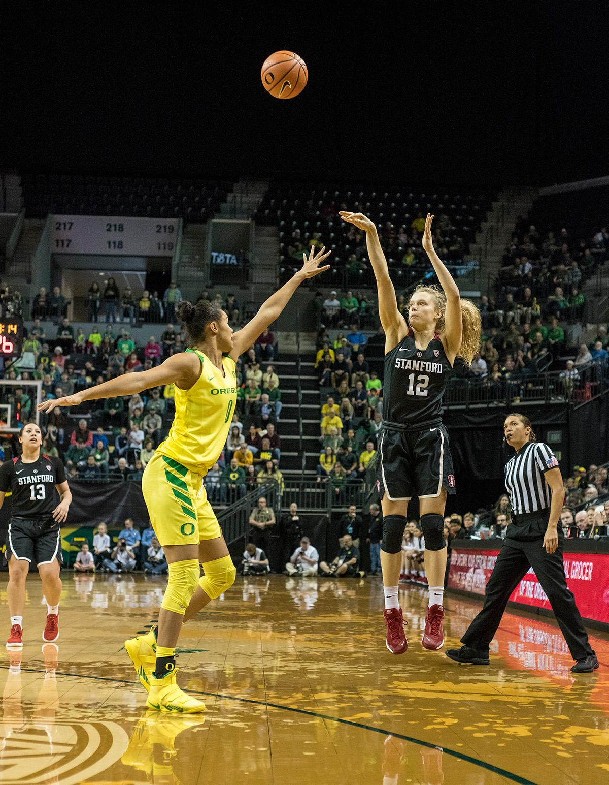 Stanford Cardinal Brittany McPhee (#12) shoots for the basket. The Stanford Cardinal defeated the Oregon Ducks 78-65 on Sunday afternoon at Matthew Knight Arena. Stanford is now 10-2 in conference play and with this loss the Ducks drop to 10-2. Leading the Stanford Cardinal was Brittany McPhee with 33 points, Alanna Smith with 14 points, and Kiana Williams with 14 points. For the Ducks Sabrina Ionescu led with 22 points, Ruthy Hebard added 16 points, and Satou Sabally put in 14 points. Photo by Rhianna Gelhart, Oregon News Lab