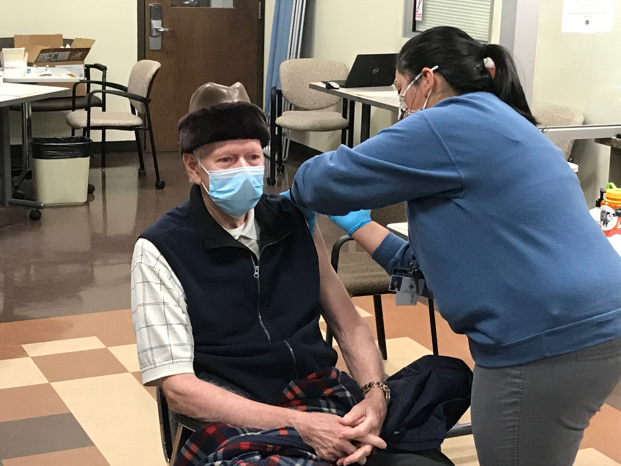 Norman Long, a Haywood County man who taught at Pisgah High from the day it opened until his retirement, received his first dose of the COVID-19 vaccine. (Photo credit: WLOS)