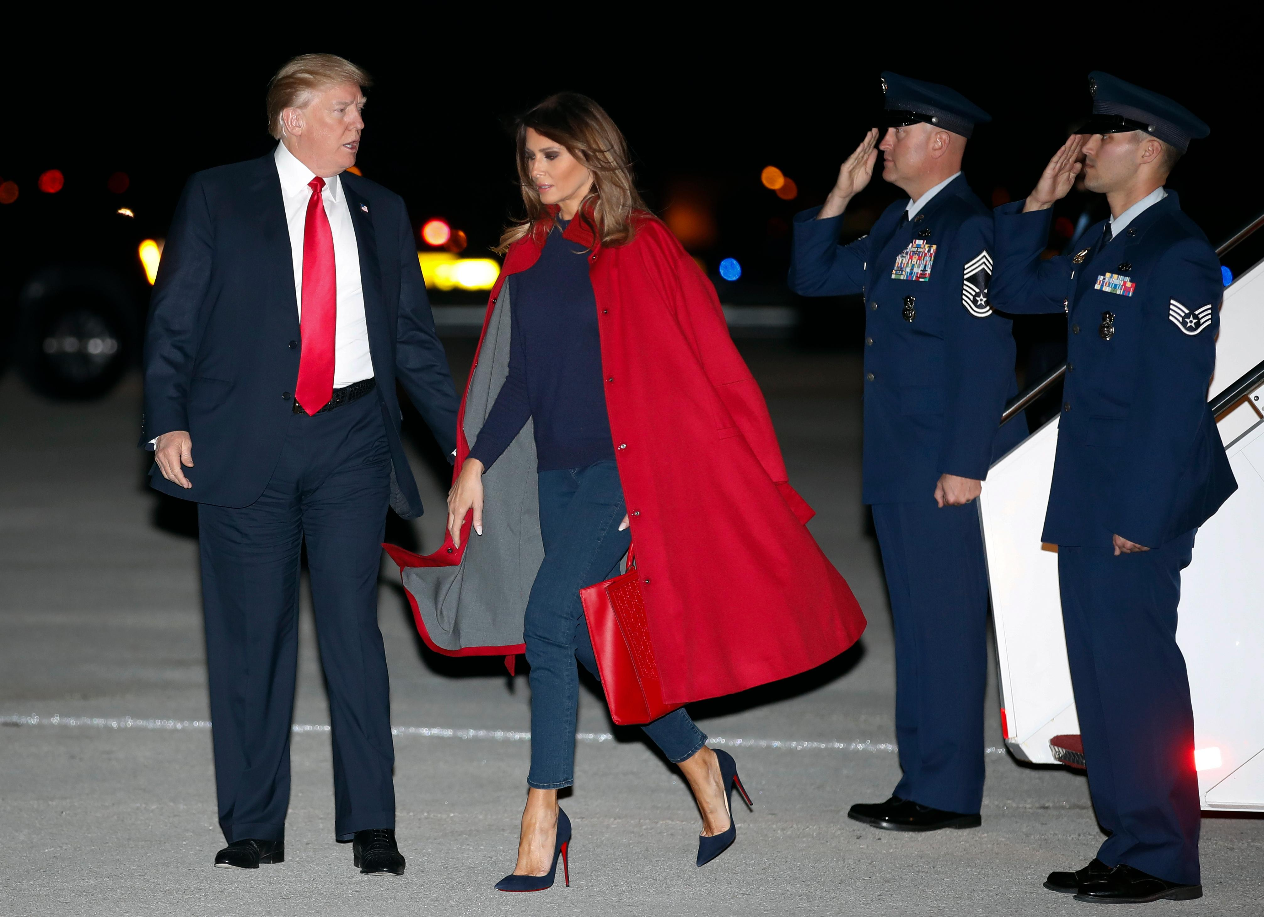 President Donald Trump and first lady Melania Trump arrive on Air Force One at Palm Beach International Airport, in West Palm Beach, Fla., Friday, Feb. 2, 2018. (AP Photo/Carolyn Kaster)