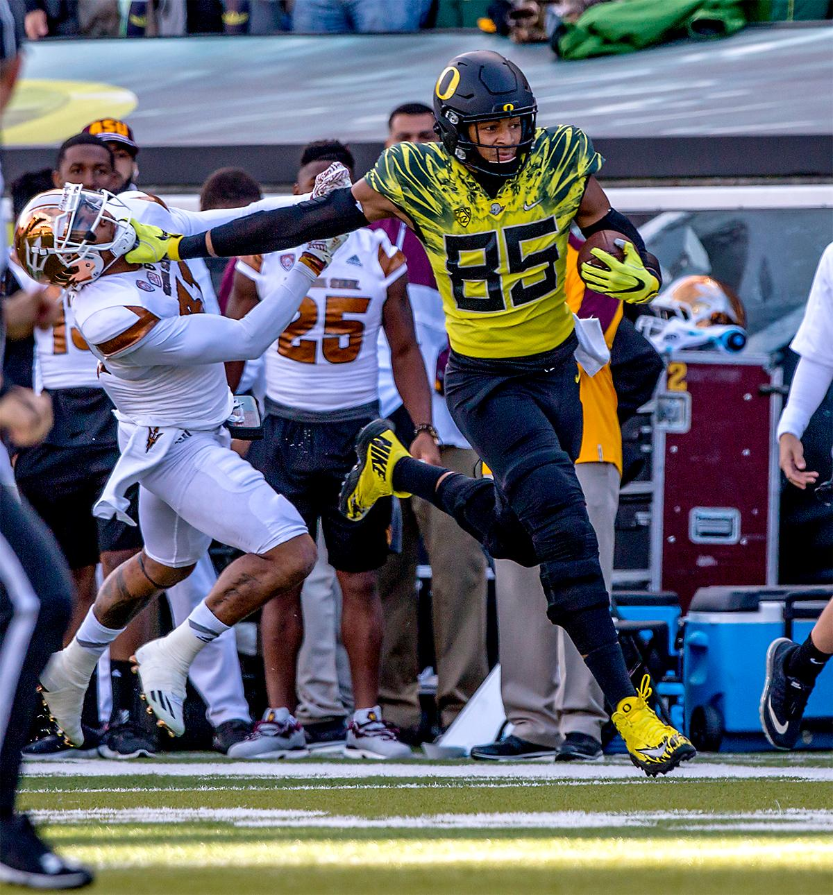The Duck's Pharaoh Brown (#85) runs the ball in for a touchdown. The Oregon Ducks broke their losing streak by defeating the ASU Sun Devils on Saturday 54-35. Photo by August Frank, Oregon News Lab