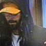 Man in 'shaggy black wig' robs Cottage Grove bank