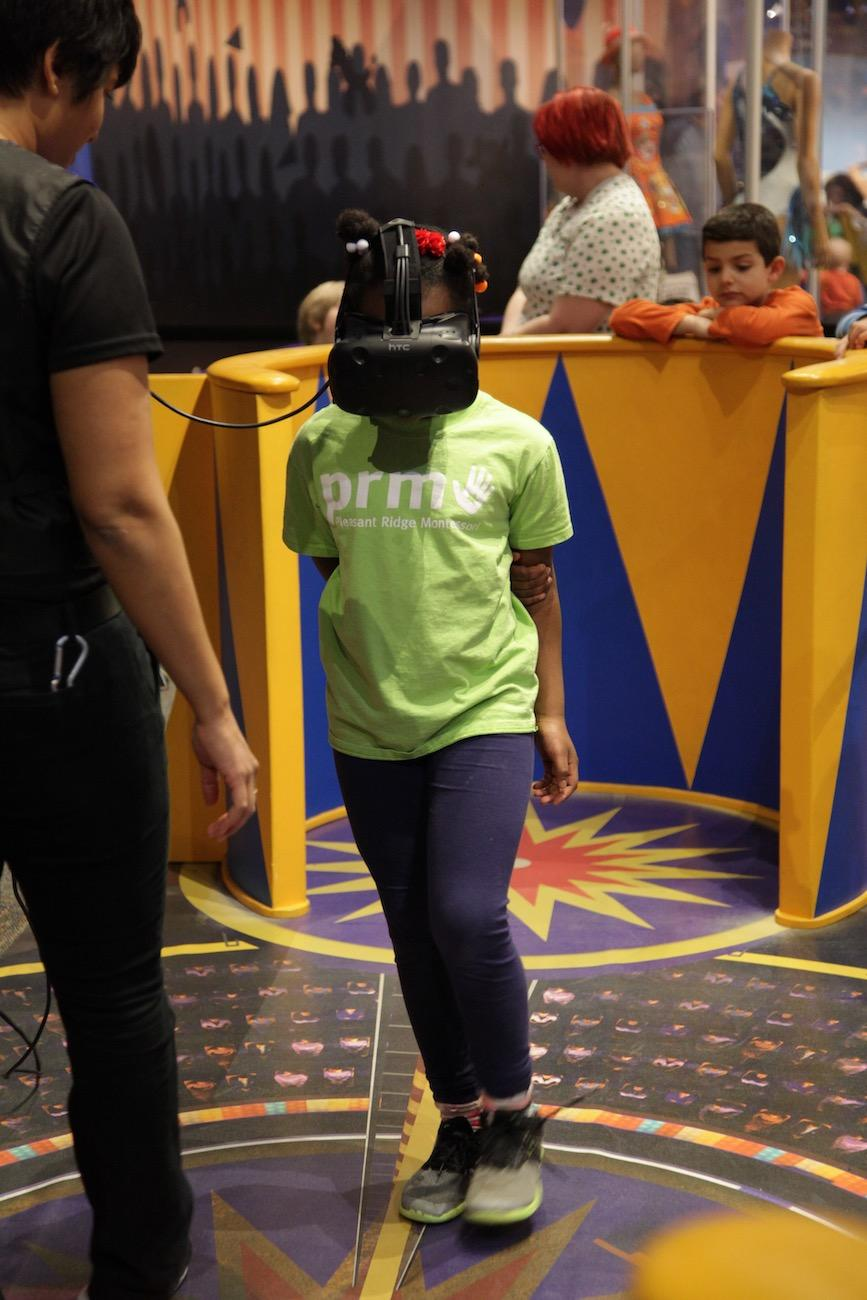 A girl tries out{ }the virtual reality tightrope walk in the museum's Circus-themed 'Starring YOU!' exhibit / Image: Chez Chesak // Published: 4.2.19