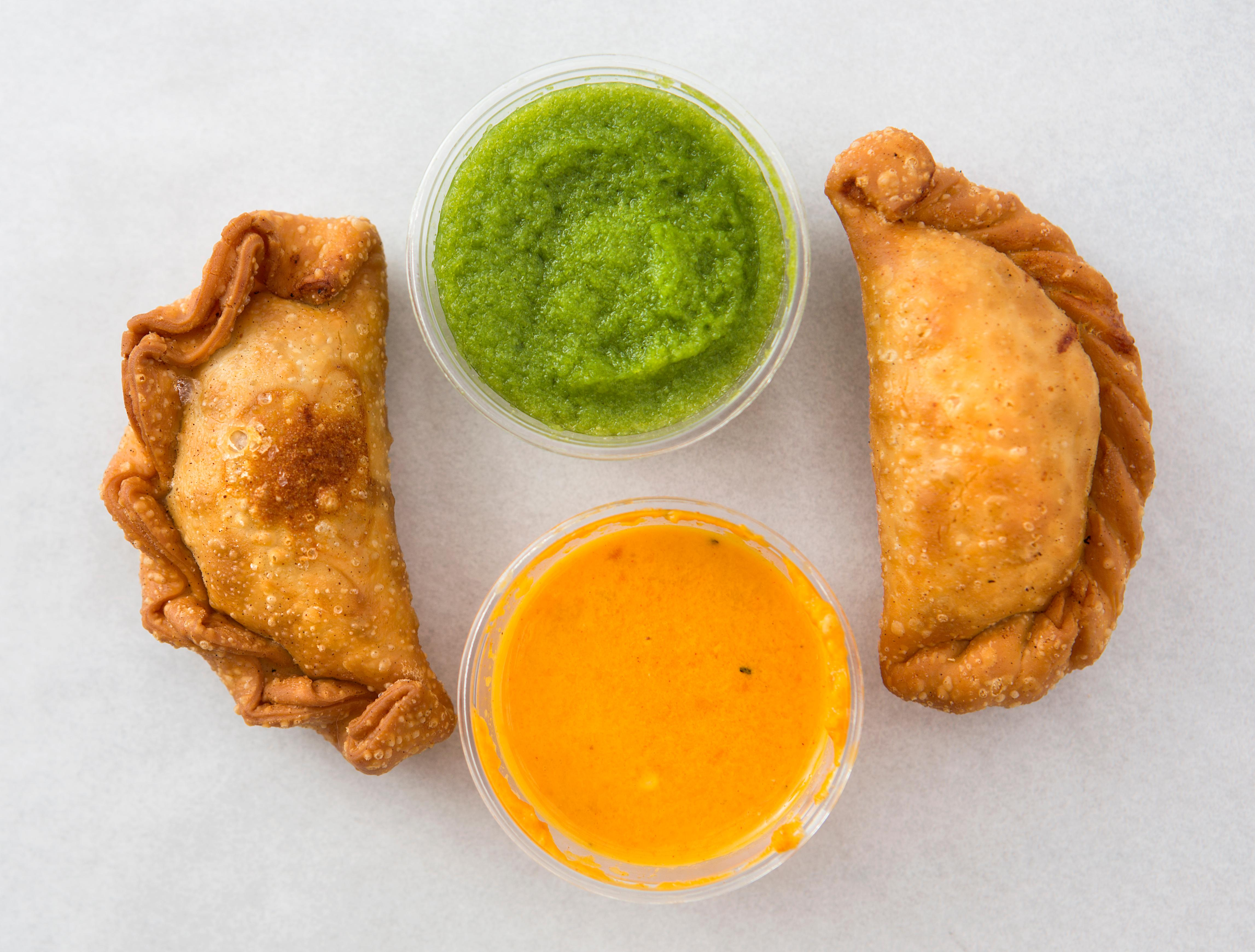 Big Chickie: Pollo a la Brasa, is a Peruvian-inspired restaurant located in Hillman City. Owner and General Manager Matt Stubbs serves up fried empanadas with various housemade hot sauces. The restaurant is located at 5520 Rainier Ave S, Seattle, WA 98118. (Sy Bean / Seattle Refined)