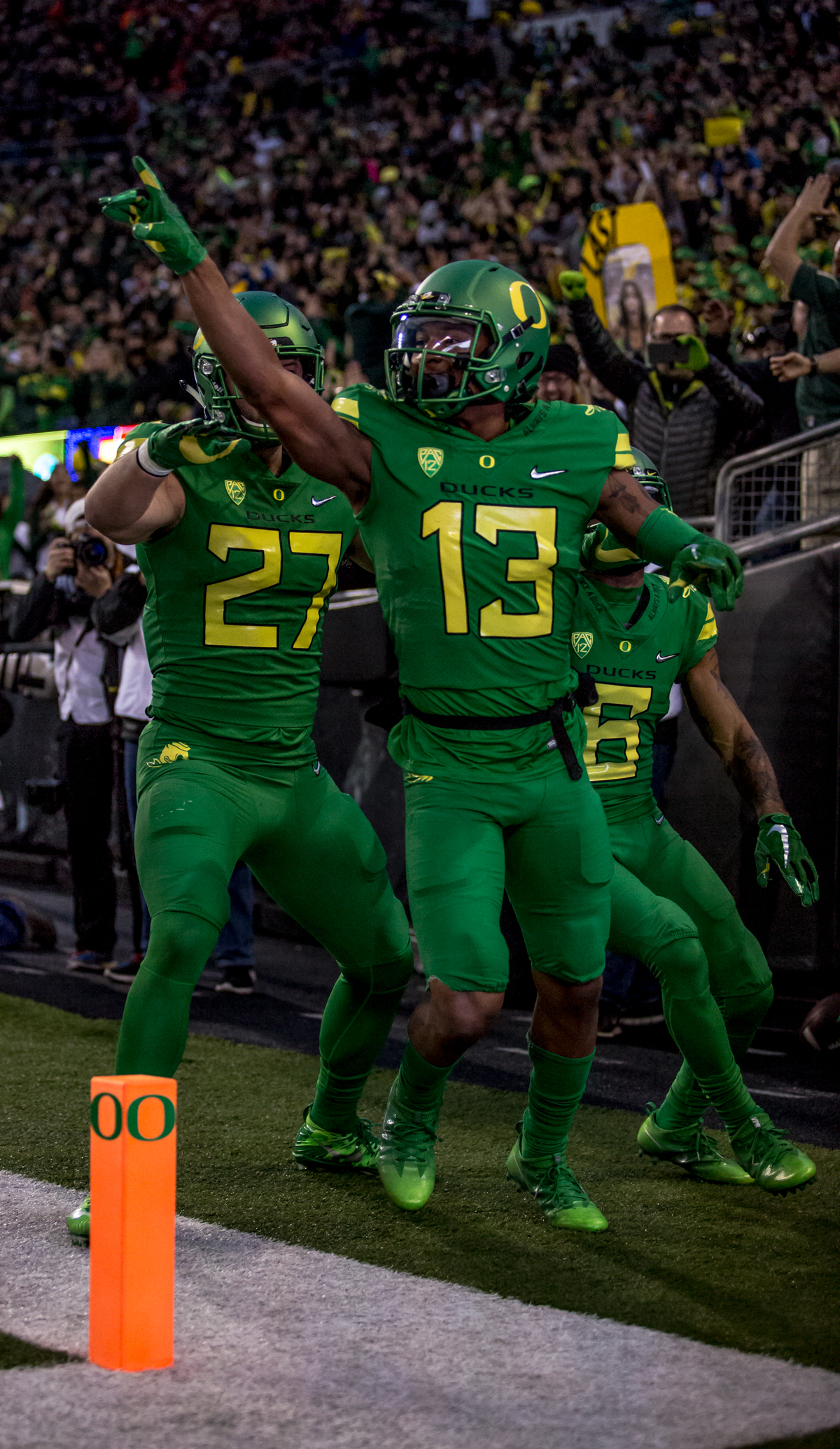 Oregon wide receiver Dillon Mitchell (#13) cheers with fellow Ducks following his touchdown catch during the first half. The Oregon Ducks lead the Oregon State Beavers 52 to 7 at the end of the first half of the 121st Civil War game on Saturday, November 25, 2017 at Autzen Stadium in Eugene, Ore. Photo by Ben Lonergan, Oregon News Lab