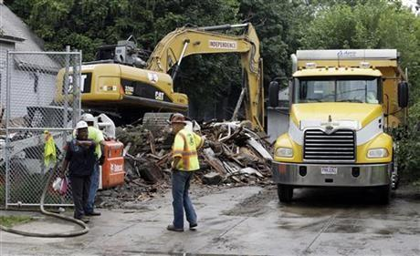 The house where three women were held captive and raped for more than a decade is demolished, Wednesday, Aug. 7, 2013