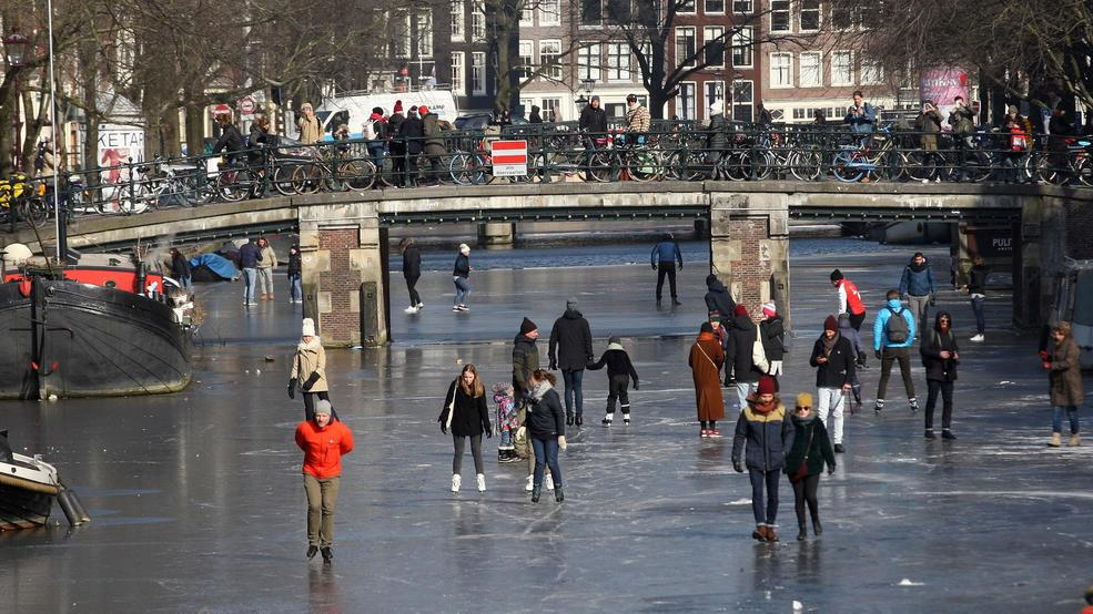 Photos: Dutch skate on frozen canals as Siberian blast continues to grip Europe