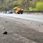 Rocks from small landslide pop driver's tires on Highway 6