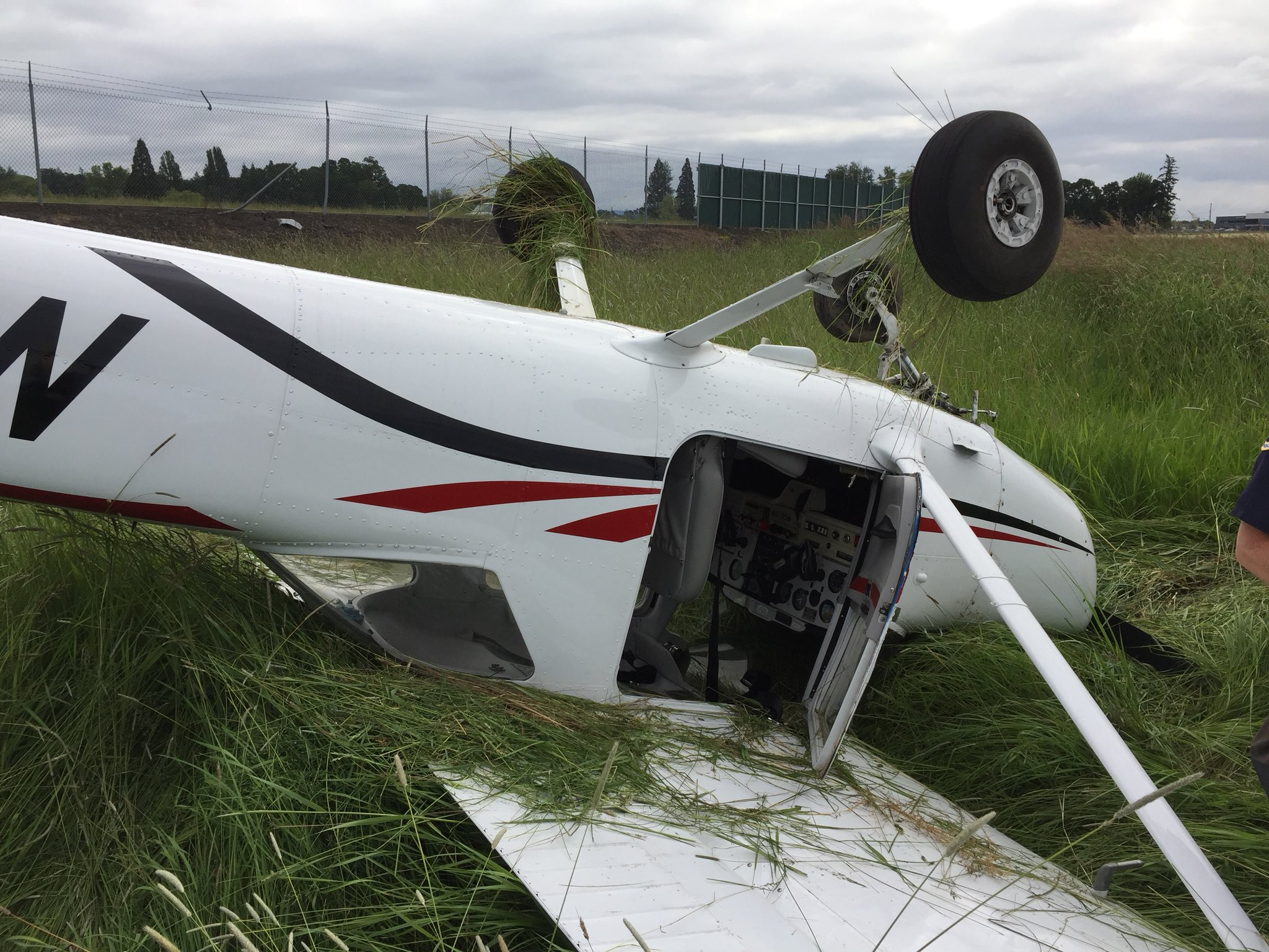 Small airplane with student and instructor inside crashes at Hillsboro Airport (Photo from Hillsboro Fire Dept.)<p></p>