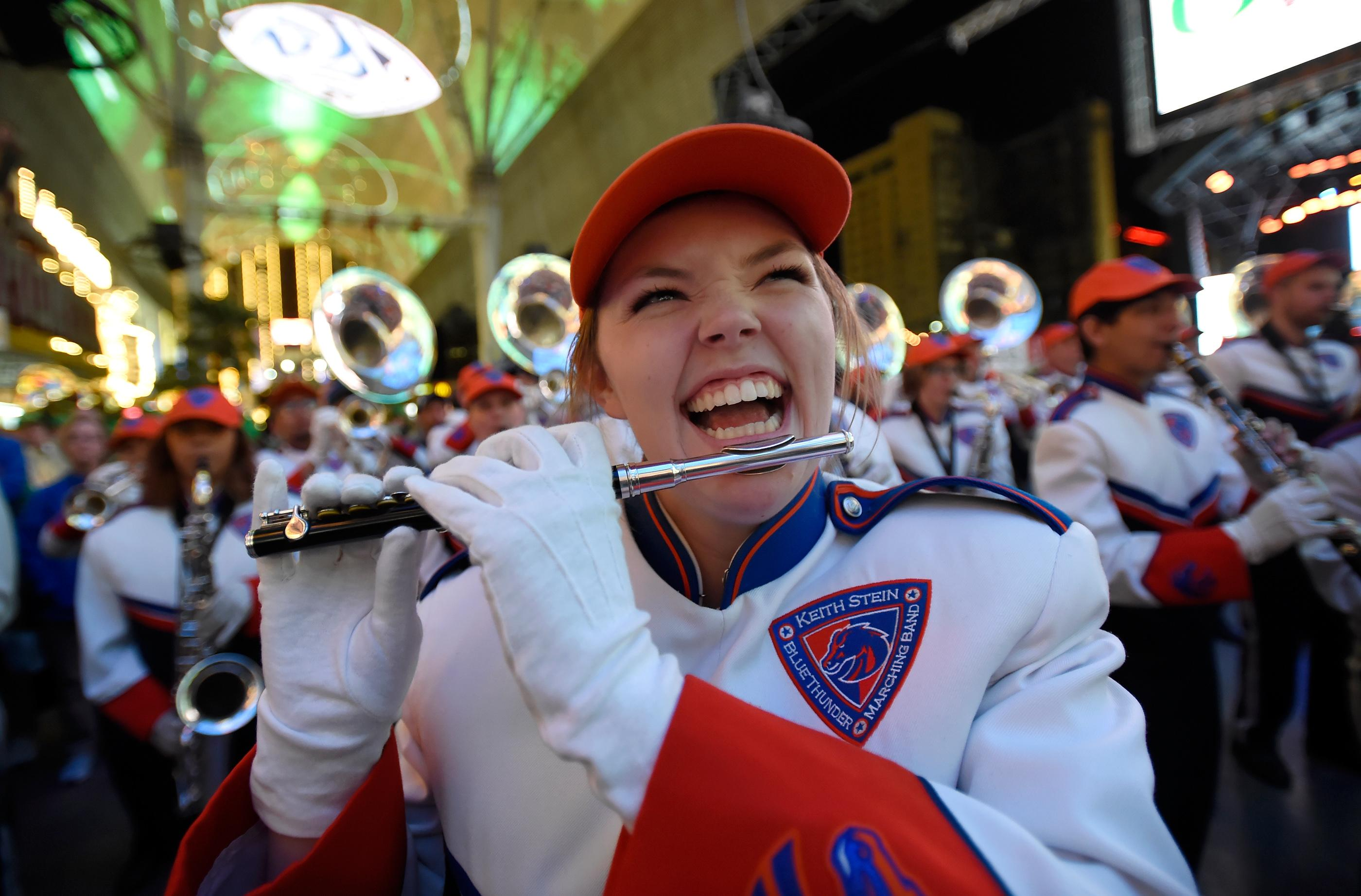 A Boise State marching band member pays her piccolo during a pep rally at the Fremont Street Experience Friday, Dec. 15, 2017, in Las Vegas. The Boise State Bronco will take on the Oregon Ducks in the 26th edition of the Las Vegas Bowl at Sam Boyd Stadium on Saturday. CREDIT: David Becker/Las Vegas News Bureau