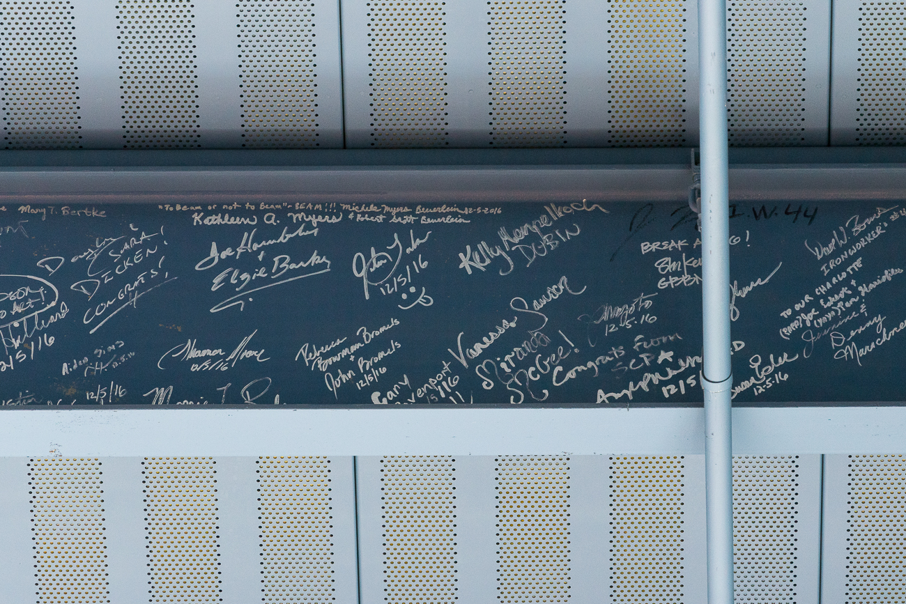 The people who make Cincinnati Shakespeare Company happen signed the final beam that was put into place to support the ceiling of the lobby's atrium. / Image: Phil Armstrong, Cincinnati Refined // Published: 9.7.17
