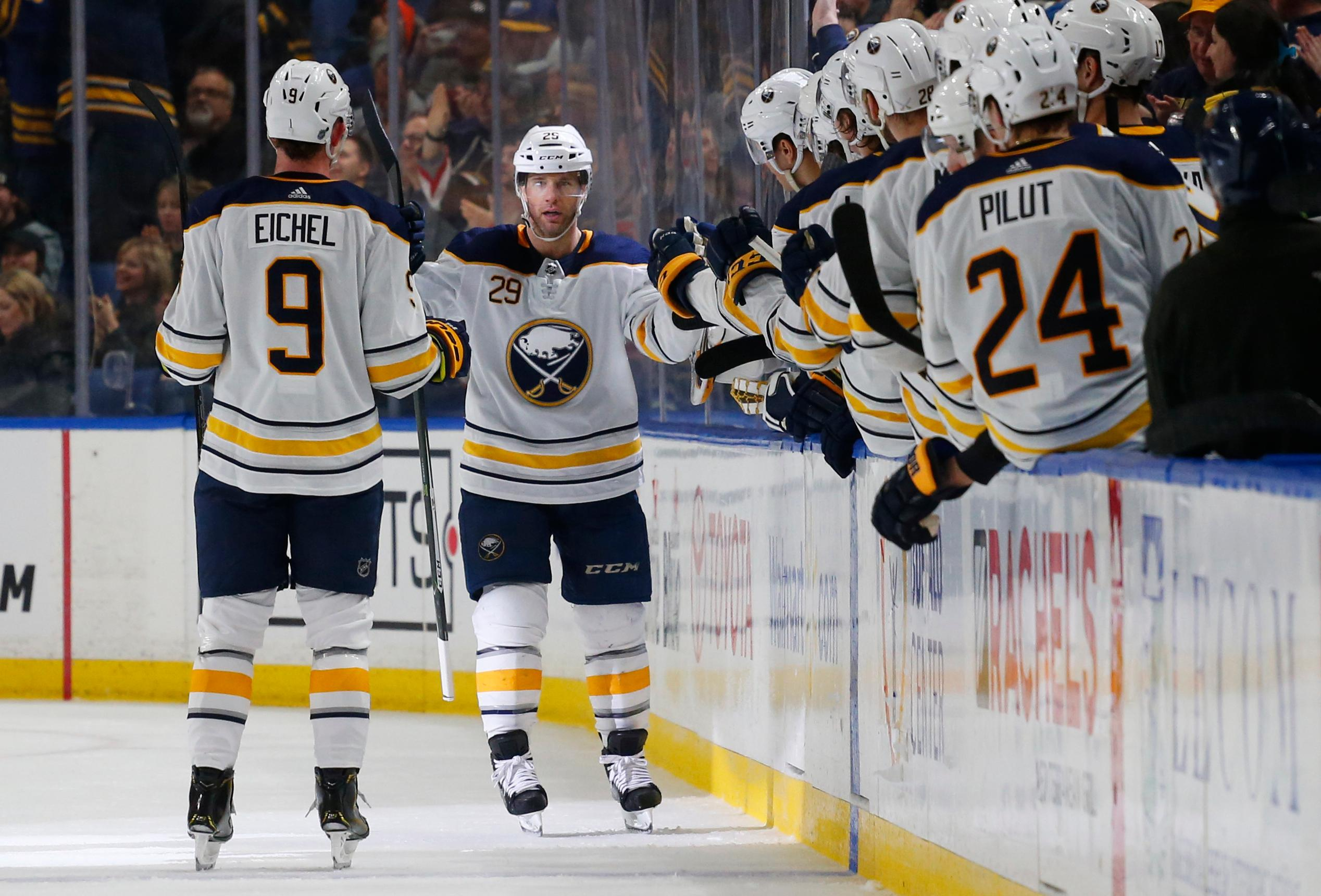 Buffalo Sabres forward Jason Pominville (29) celebrates his goal with teammates during the second period of an NHL hockey game against the Carolina Hurricanes, Thursday, Feb. 7, 2019, in Buffalo N.Y. (AP Photo/Jeffrey T. Barnes)
