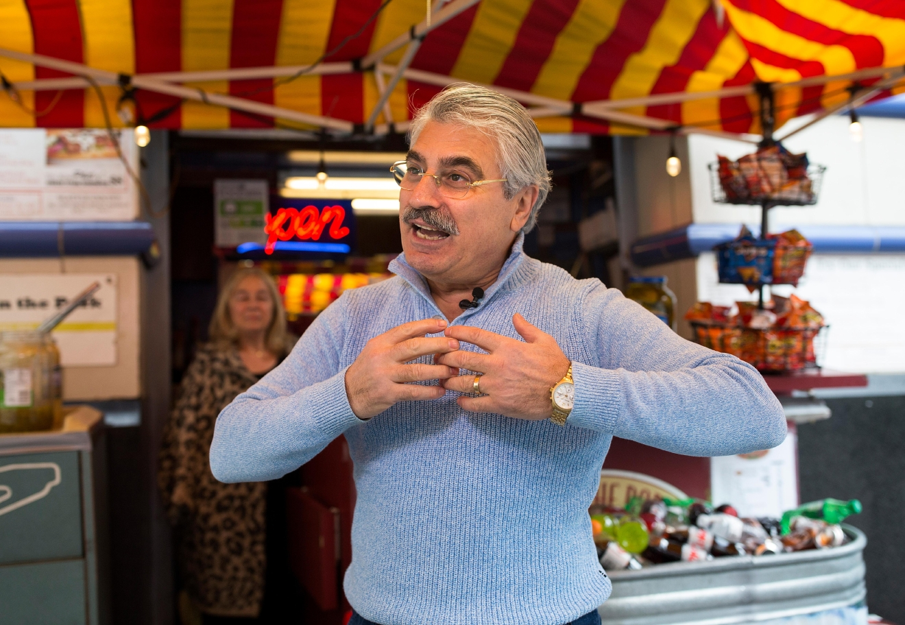 Dog In The Park owner Ramazan Senturk claims he created the first Seattle Dog at his hot dog stand at Westlake Park. (Sy Bean / Seattle Refined)