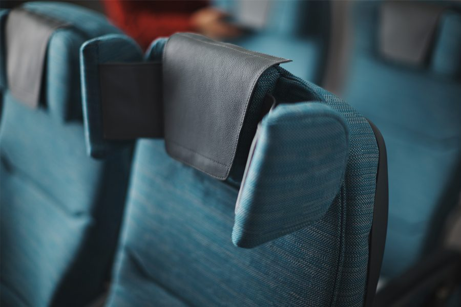 Added plane features, like adjustable headrests, make this flight route a smart pick for long-haul travel.{&amp;nbsp;}(Image: Courtesy Cathay Pacific)<p></p>