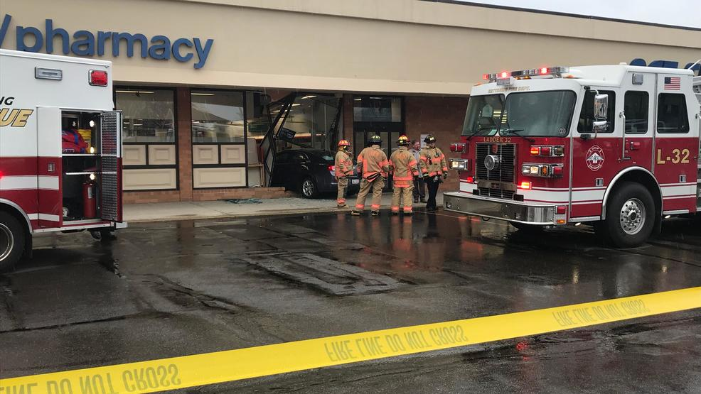 no one injured after car crashes through front of cvs in kettering