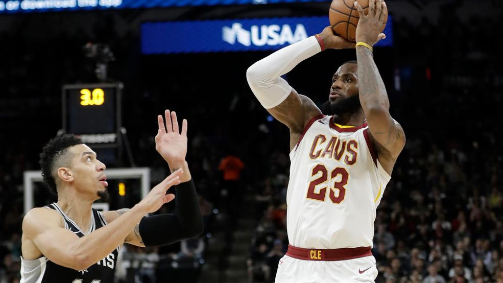 ed728fb588f Cleveland Cavaliers forward LeBron James (23) shoots and scores over San  Antonio Spurs guard Danny Green (14) during the first half of an NBA  basketball ...