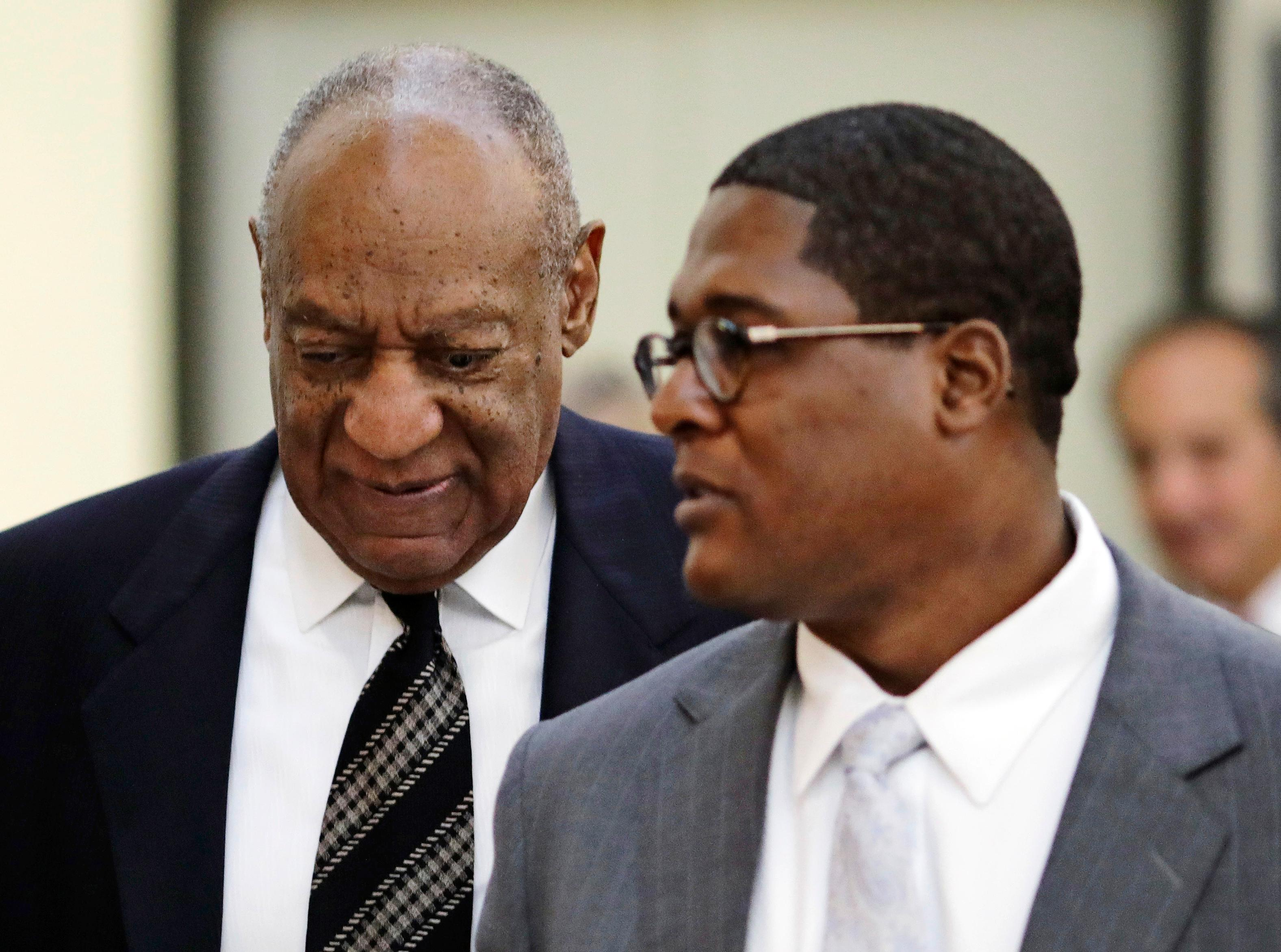 Actor and comedian Bill Cosby, left, and his spokesman Andrew Wyatt, return to the courtroom after a recess in Cosby's sexual assault retrial at the Montgomery County Courthouse,  Monday, April 16, 2018, in Norristown, Pa.  (Dominick Reuter/Pool Photo via AP)
