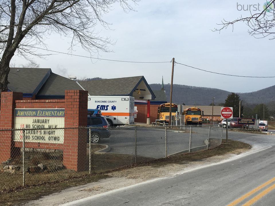Police and emergency crews are on scene at Johnston Elementary School in Asheville after multiple students were reportedly pepper sprayed. (Photo credit: WLOS Staff)