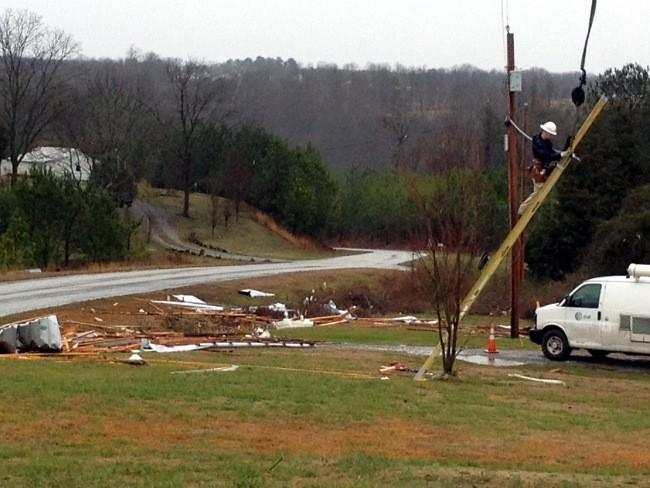 AT&T crews worked to repair phone lines damaged by high winds in Winston County.