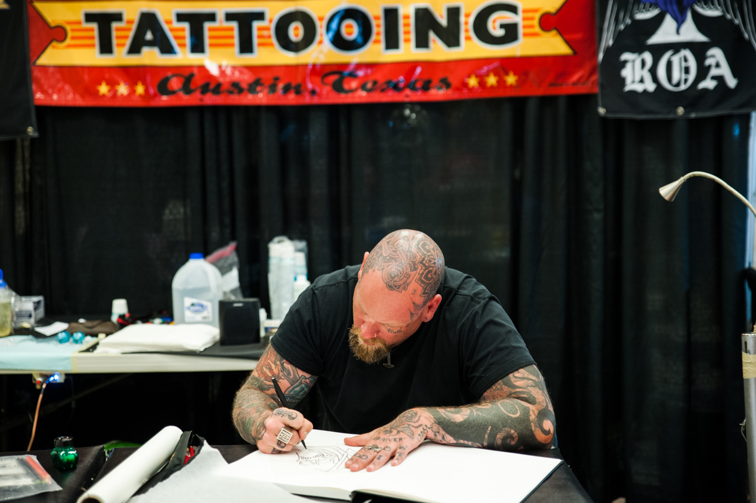 Thousands of tattoo enthusiasts came out to the 2019 Seattle Tattoo Expo. Vendors from all over the country came to Seattle Center giving consultations and tattooing clients right at the expo. (Image: Elizabeth Crook/ Seattle Refined)