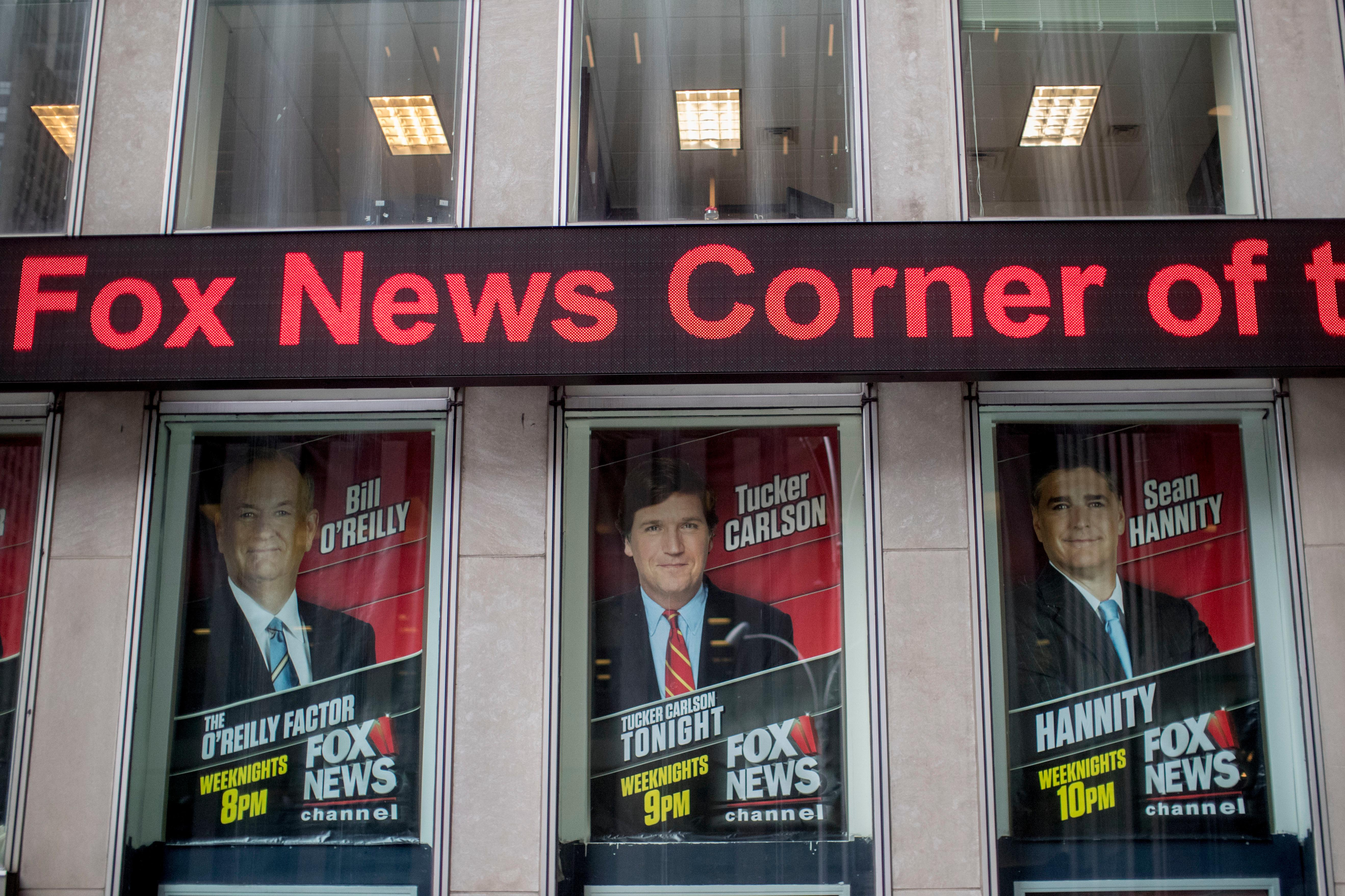 Posters of Fox News Channel personalities are displayed at the News Corp. headquarters in New York, Wednesday, April 19, 2017. There was no immediate response from Bill O'Reilly's bosses to escalating reports that the Fox News Channel personality will lose his job following accusations he had harassed women. New York magazine said Wednesday that Rupert Murdoch and his sons James and Lachlan, who run Fox parent 21st Century Fox, had decided that O'Reilly was out and executives were planning  the exit. (AP Photo/Mary Altaffer)